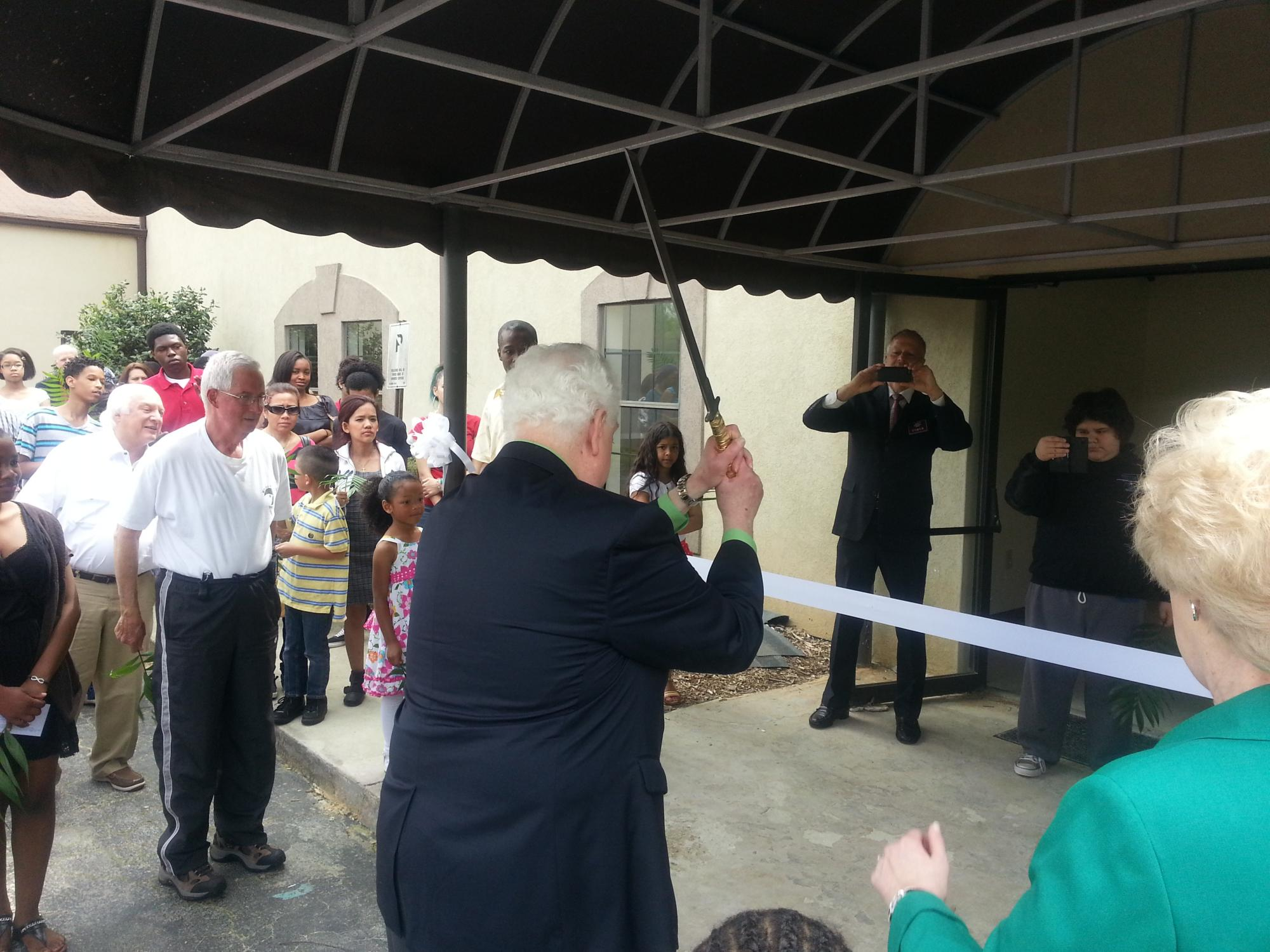 Pastor_Fred_Cutting_the_Ribbon.JPG