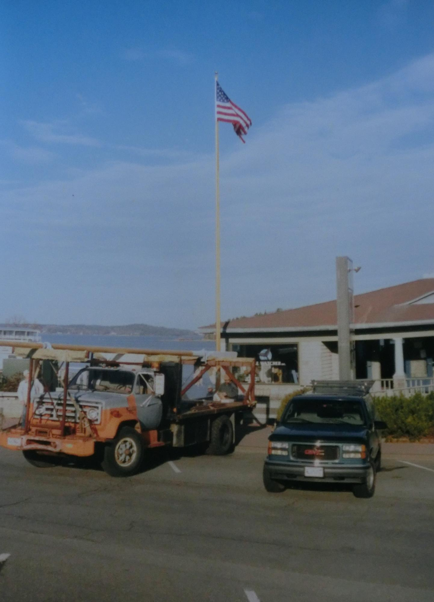 Installing the flagpole at Harbor Place