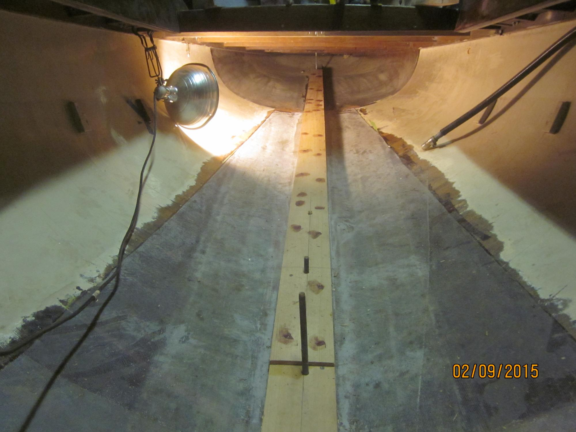 outside_veneers_repaired__interior_stripped__inside_of_hull_glassed__new_keel_batten_installed.JPG