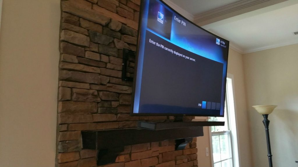 Stone-fireplace-tv-mounting-in-charlotte-nc-1024x575.jpg