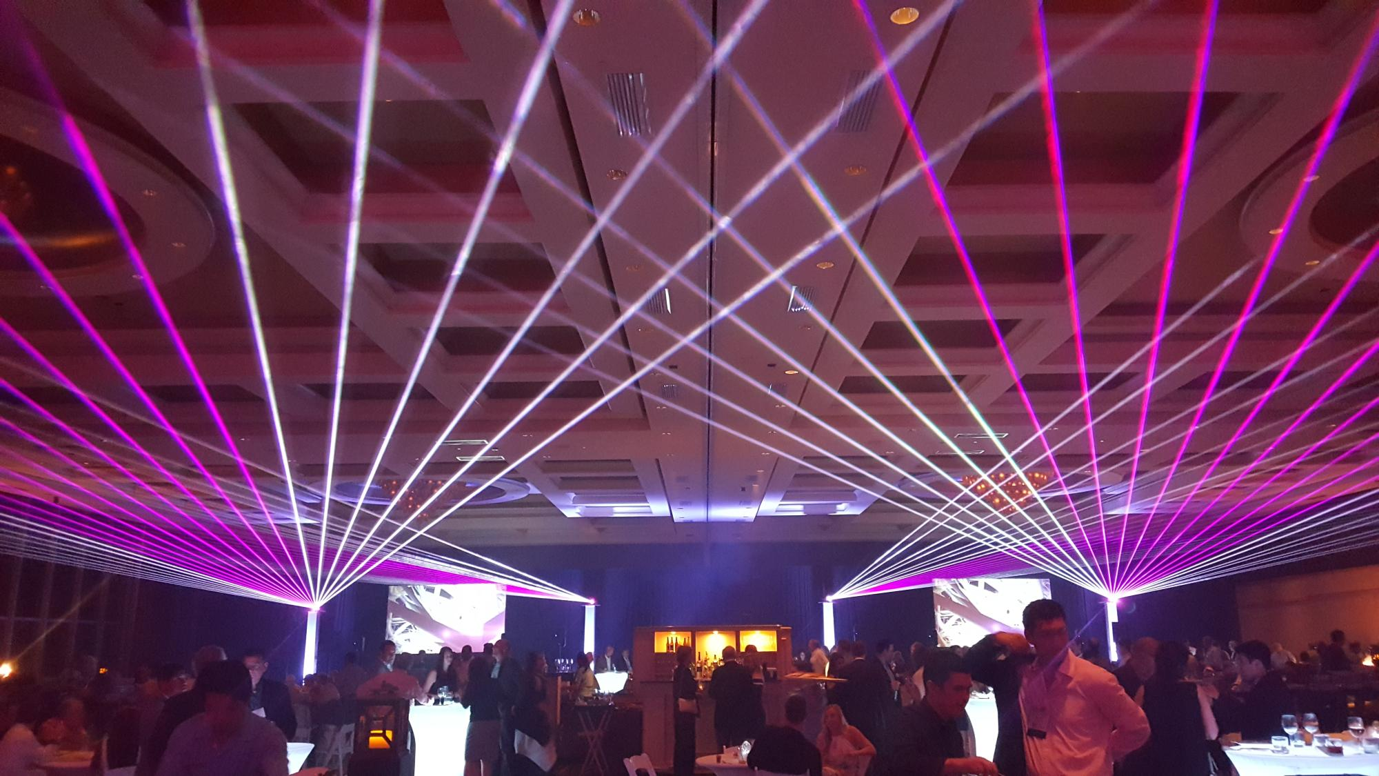 Pink lasers for corporate events by United Laser
