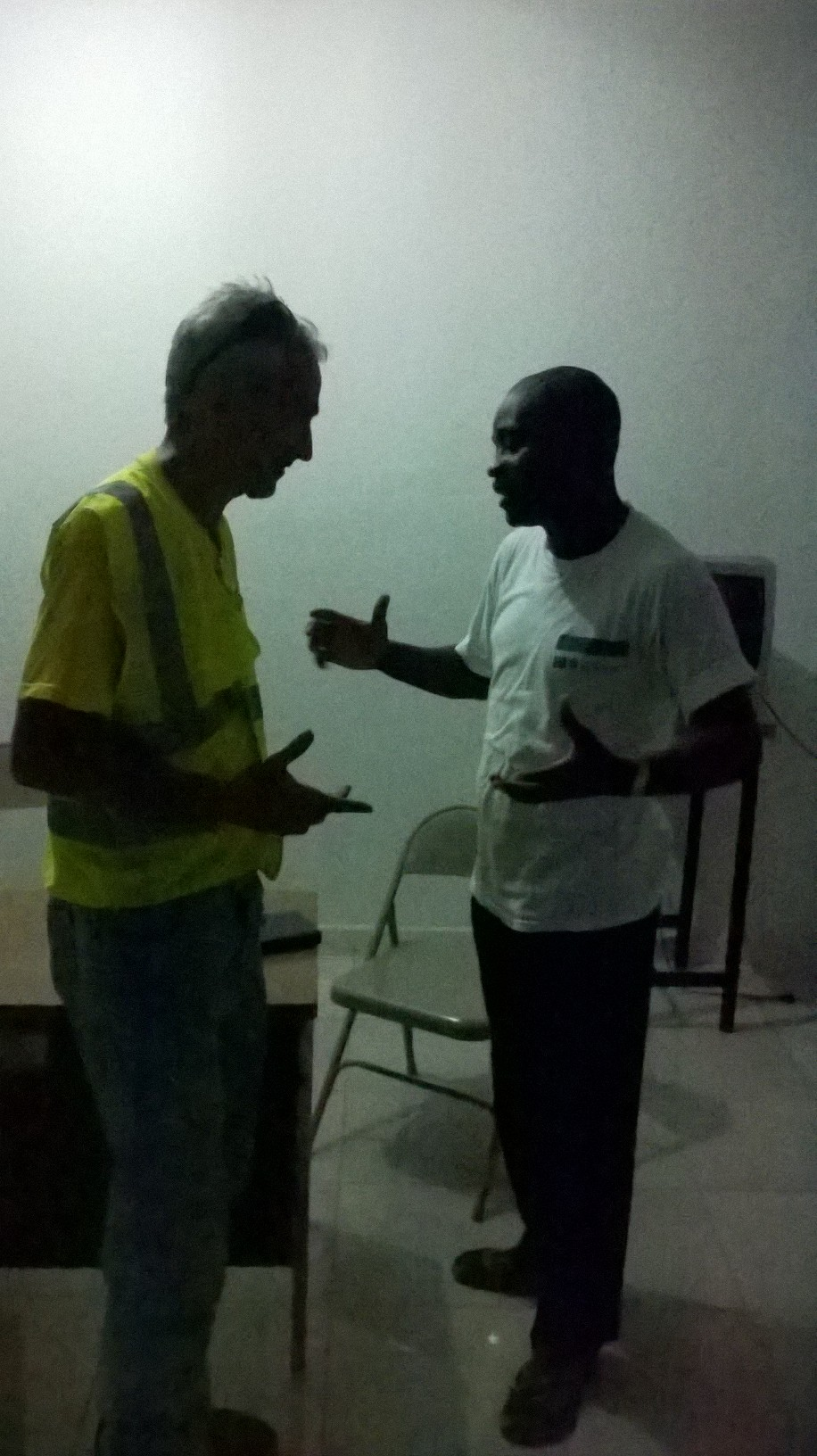Dr_Lamartine_Pierre_Fils_director_of_the_State_Health_Center_of_ANSES_a_PITRES_and_Dr_Large_discussing_Eye_Care_2015_aug_21_WP_20150821_010.jpg
