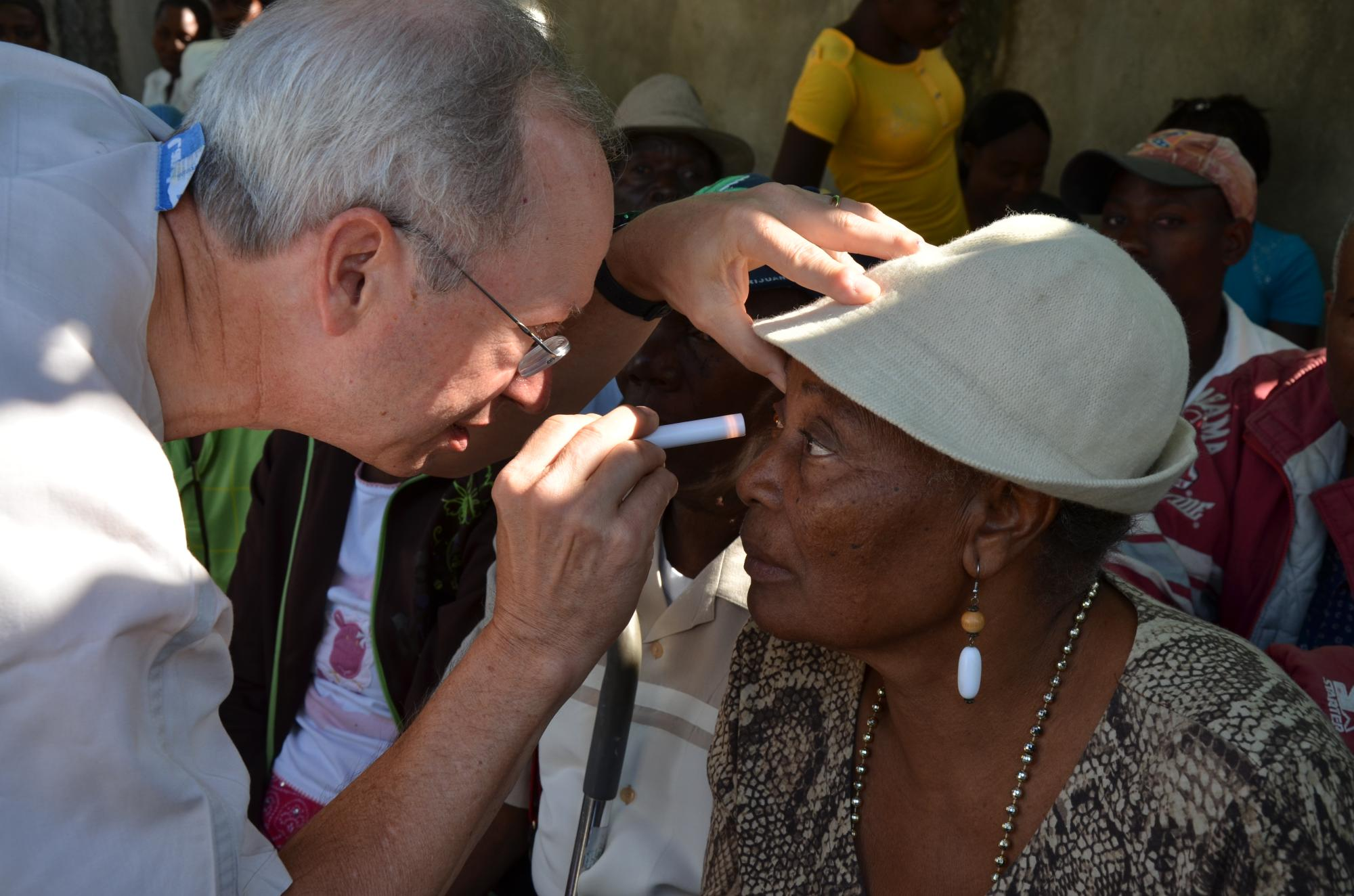Haiti2013_Dr_Sloan_eye_surgeon_flashlight_exam_398.jpg