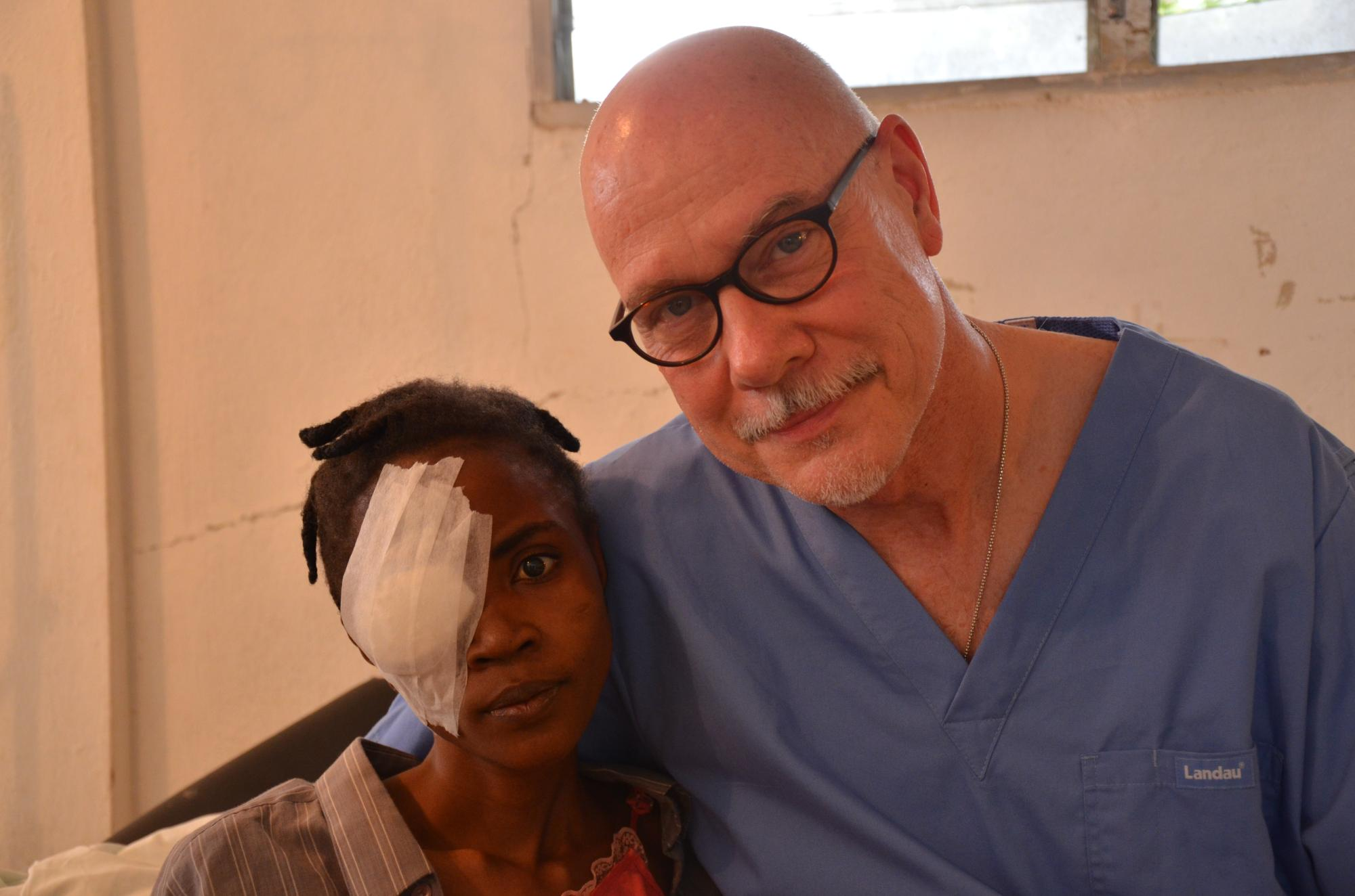 Haiti2013_Dr_sloan_w_Juna_post_surgery_915.jpg