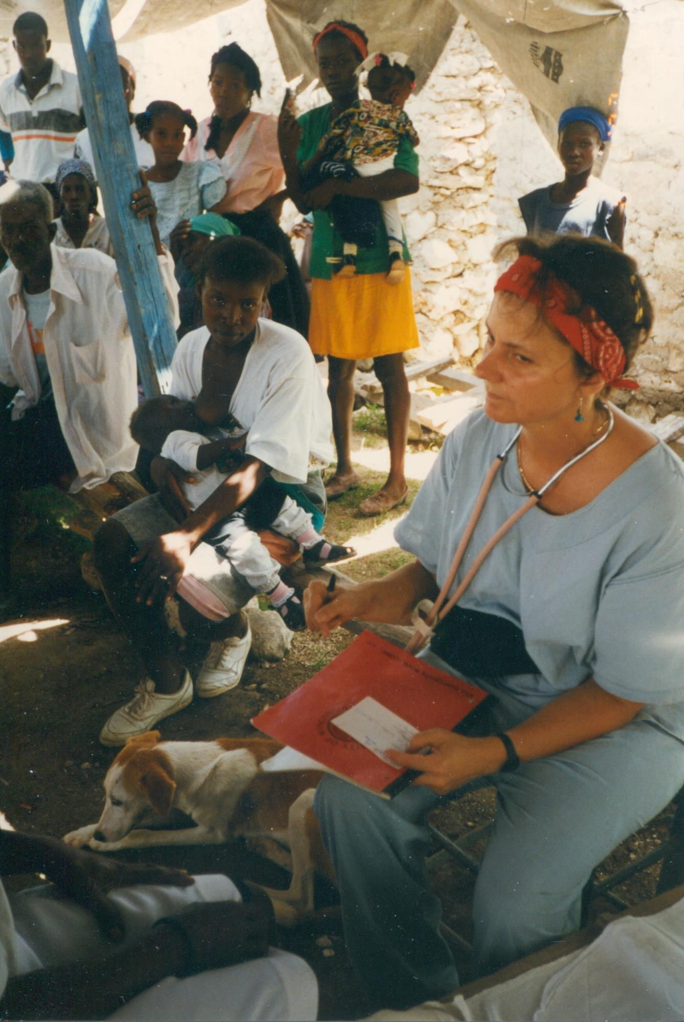 Team_members_in_temp_clinic_tent_w_patients_June_1997_image89.jpg
