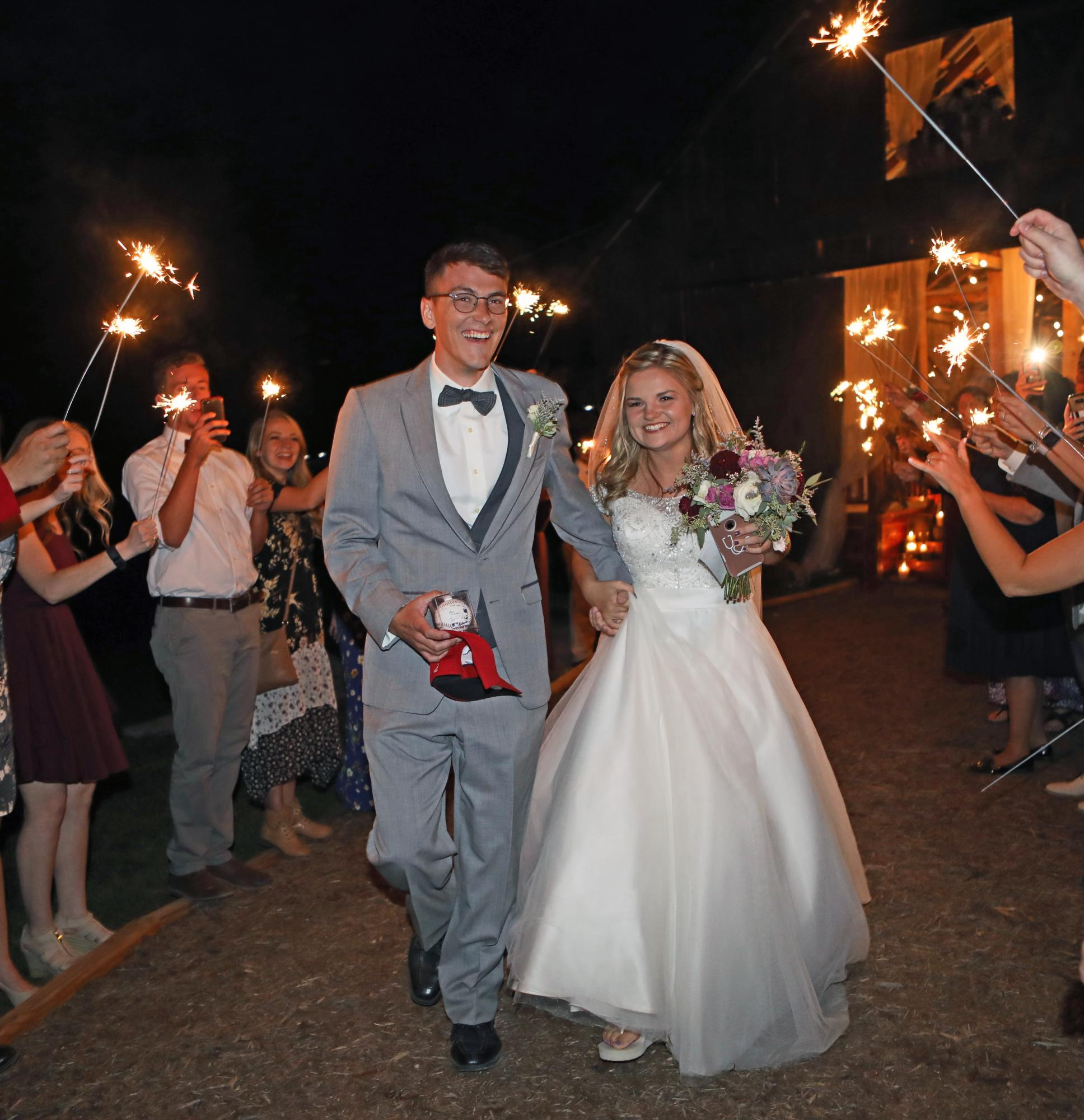 17__Groom_Bride_exiting_Sparklers.jpg