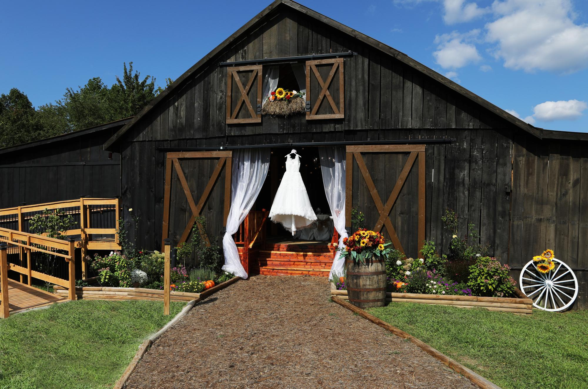 22__wedding_dress_hanging_on_event_barn.jpg