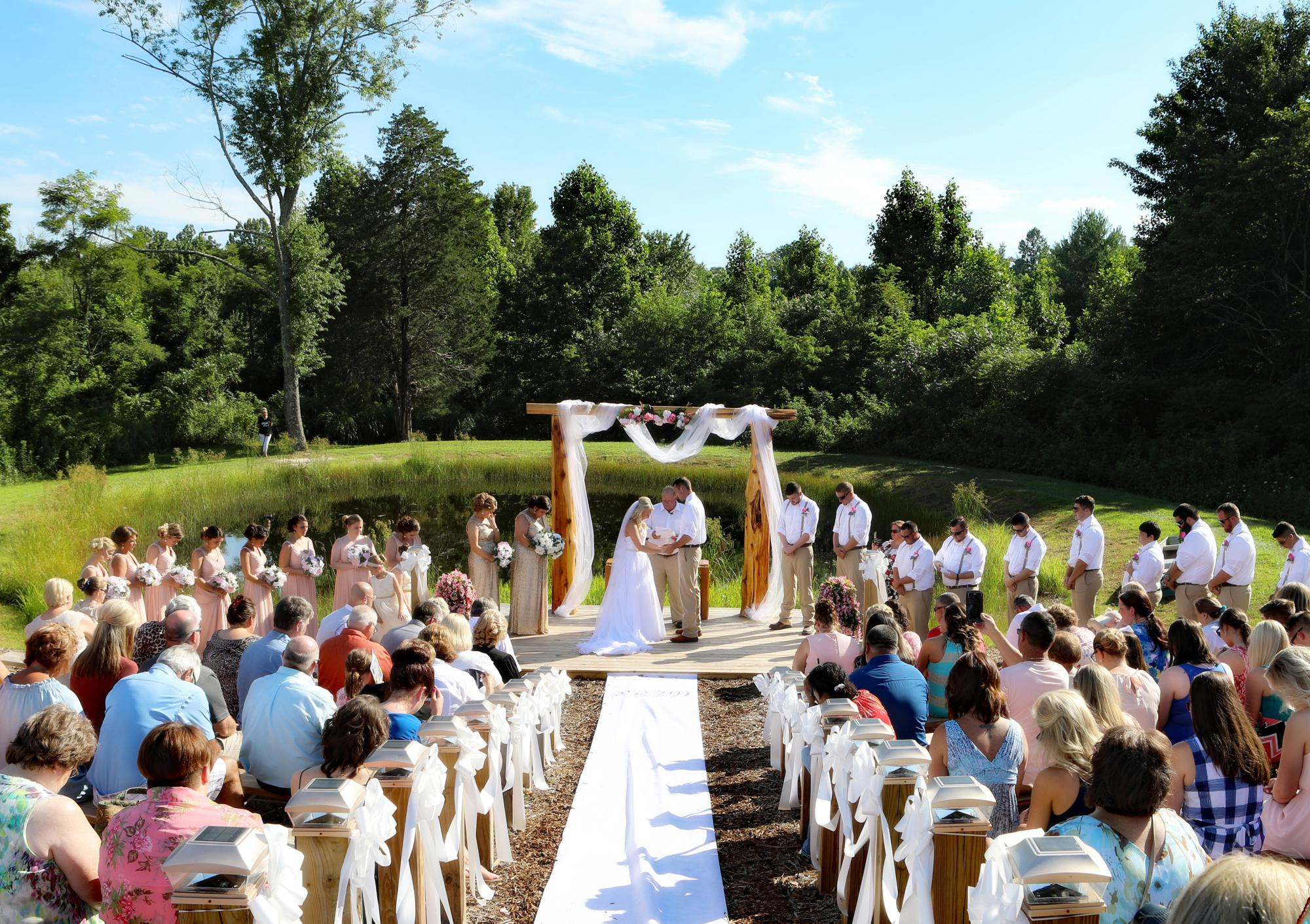 31__wedding_at_the_pond_praying.jpg