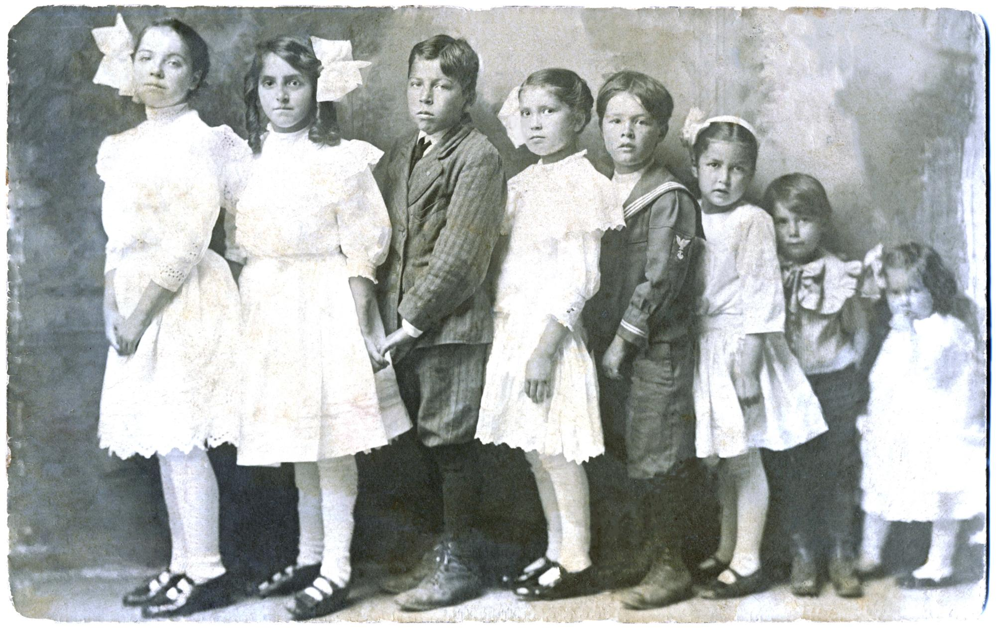 "Ethel McKinnon, Sarah McKinnon, Lester Hoover, Florence Hoover, Percy McKinnon, Mildred Hoover, William Teddy Marlow, Marieta ""Sissy"" Marlow, left to right"