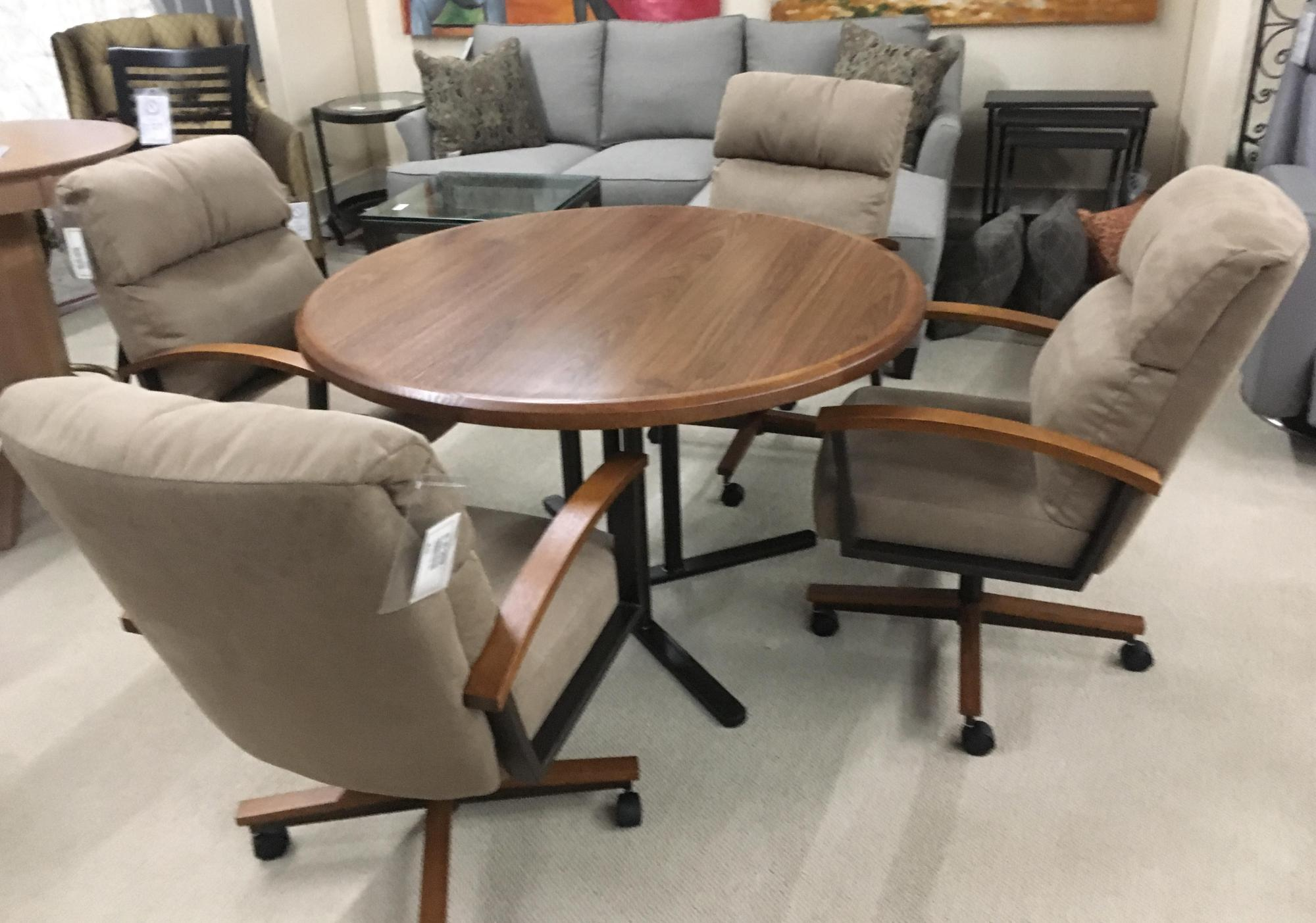 "48"" Round wood/metal table with 4 chairs on casters"