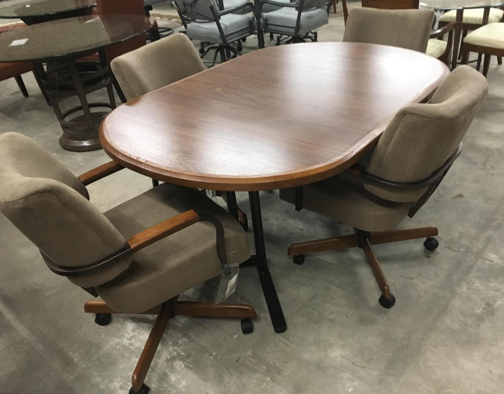 "Wood top with metal base table and 4 chairs on casters, 48"" round with 18"" leaf"