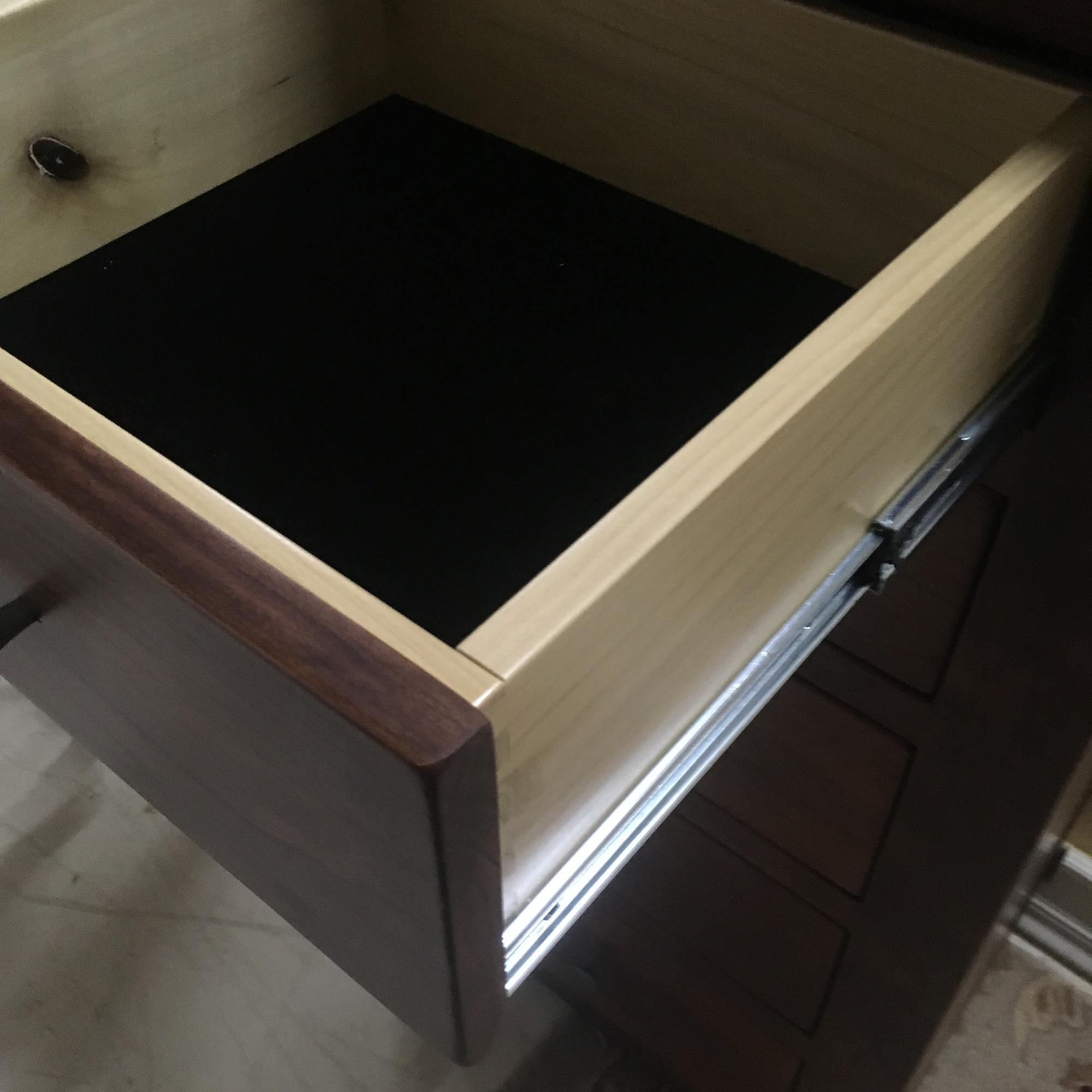 Drawer construction is solid wood with roller bearing glides