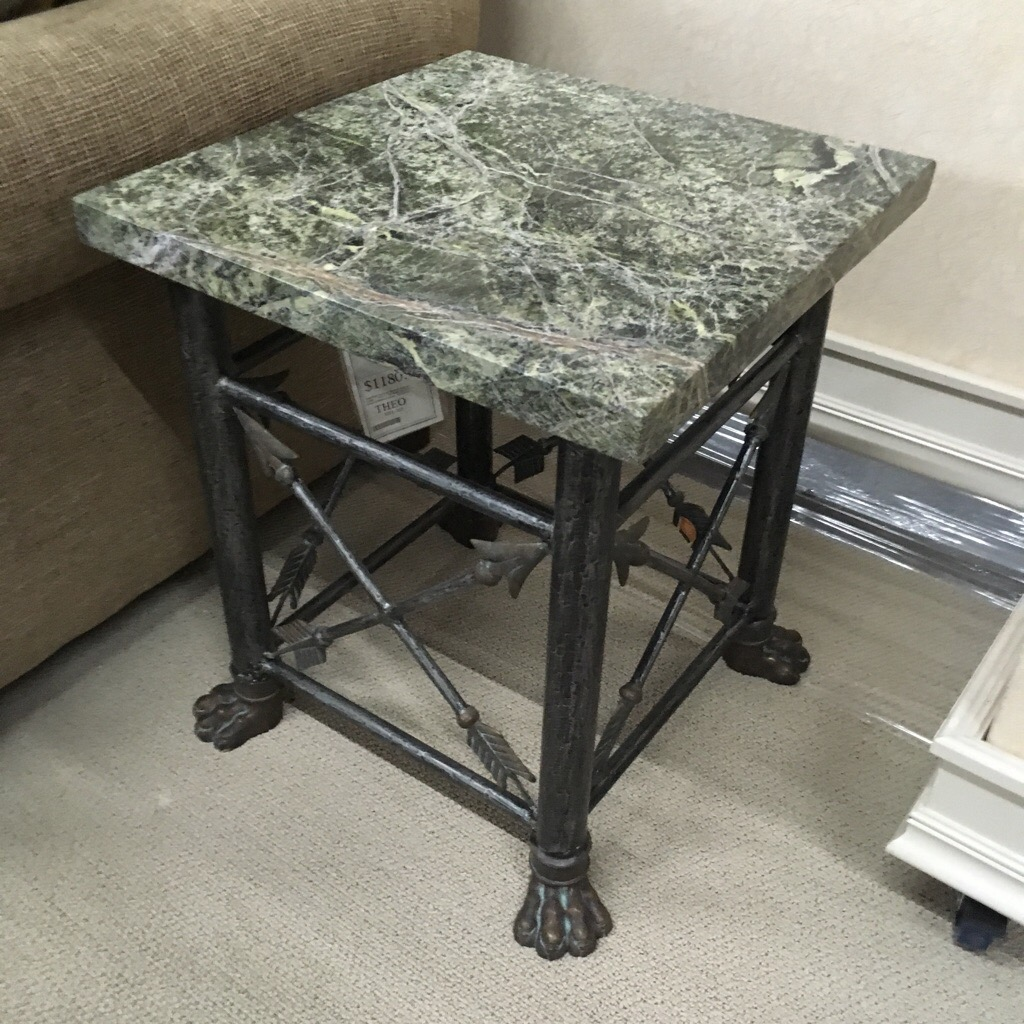Rainforest Marble top on iron and bronze base with arrow head accents