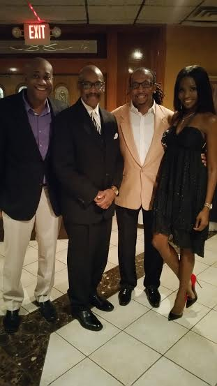 FLAVUH matriarch Shannone Holt (right), her brother Princeton (far left) and their dad,  Pastor Princeton Holt pose with Wayne at the 74th Annual Rev. Richard L. Taylor NAACP Freedom Fund Awards.