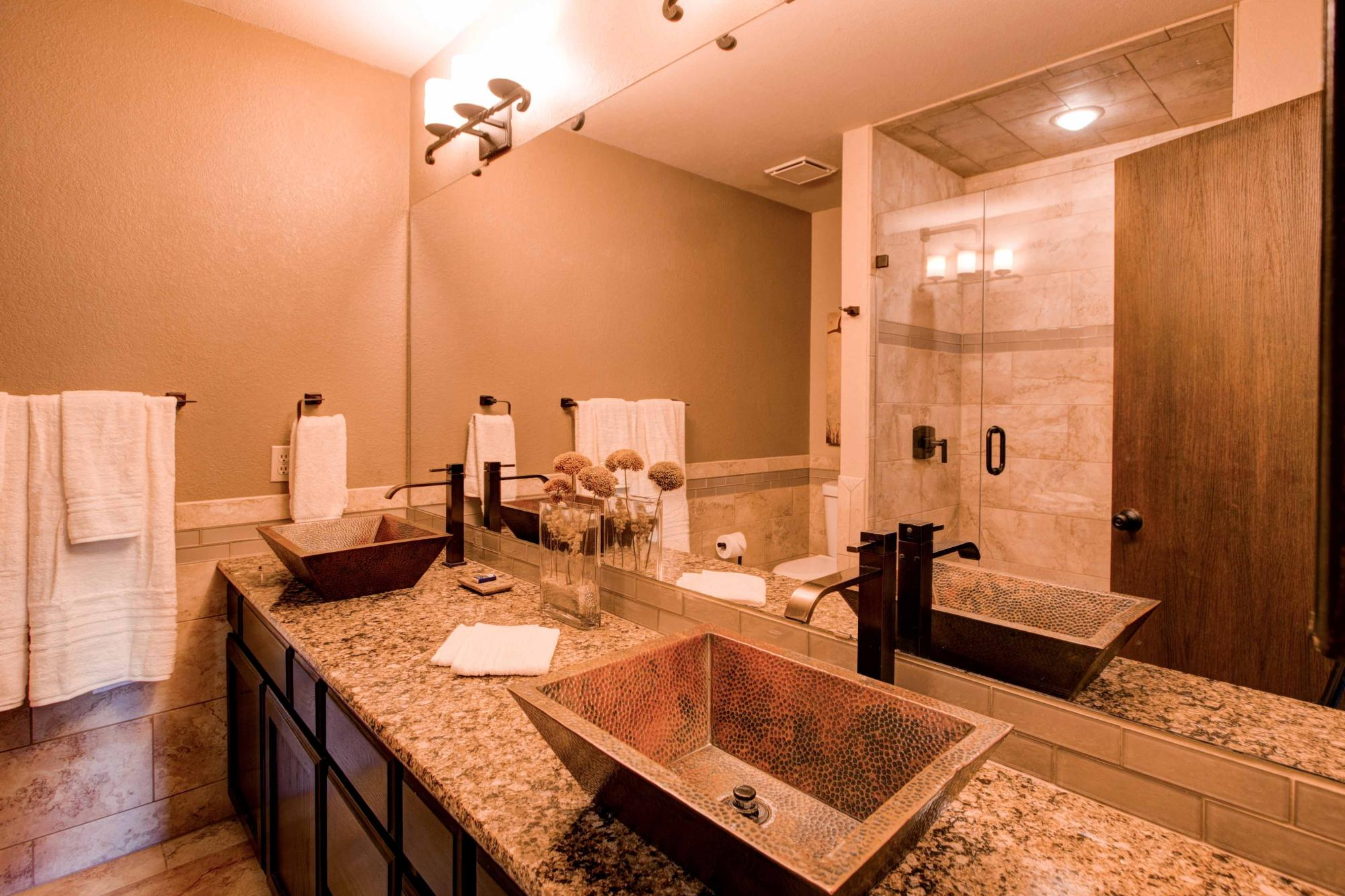 Master bath, dual vanity boasts hammered copper sinks