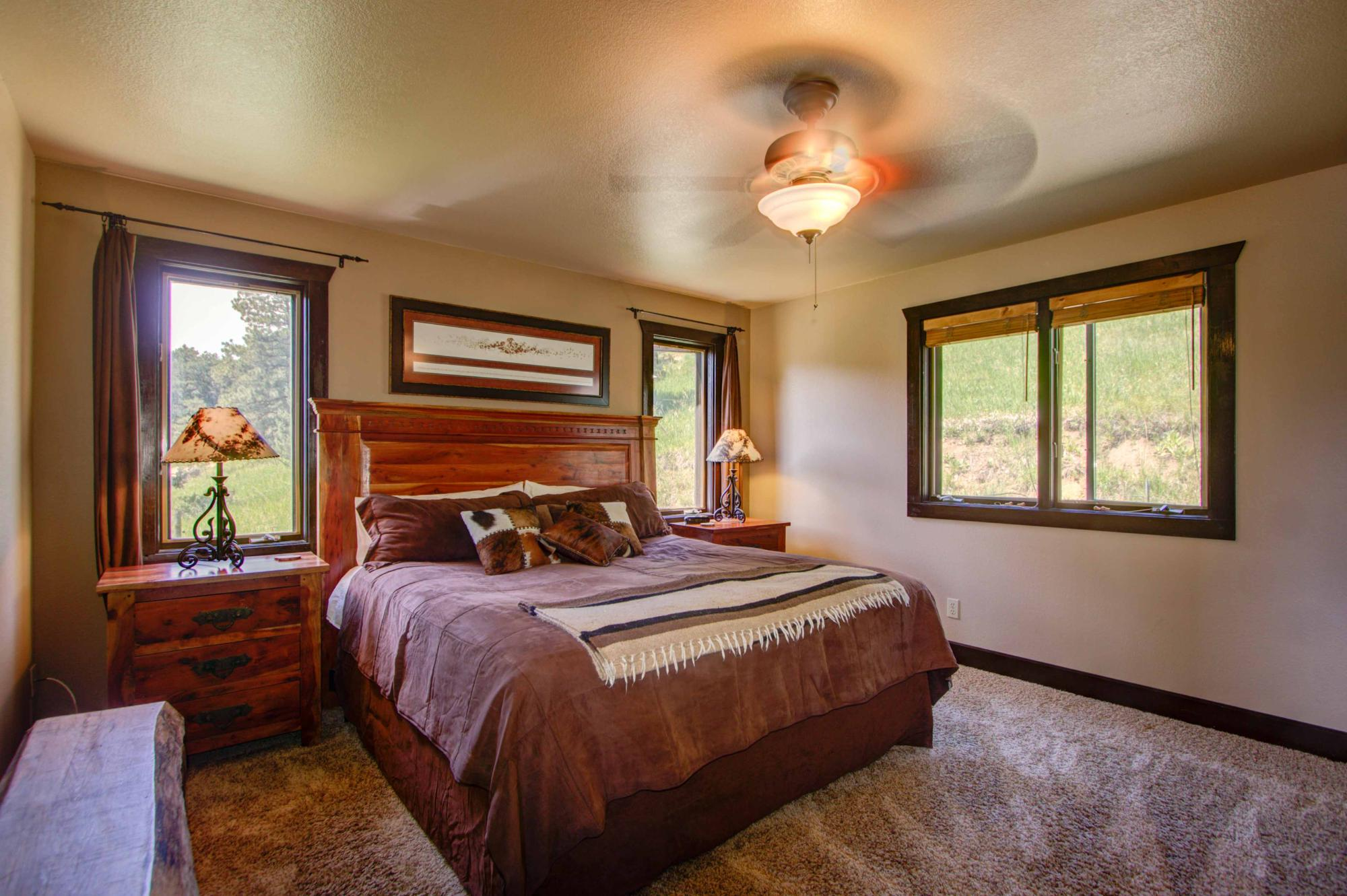 Master bedroom with king bed, on the main  level. Flat screen TV in the armoire