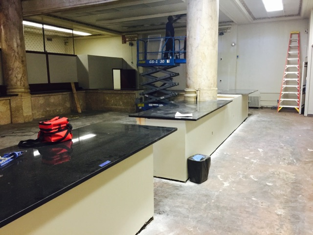Install new Granite Counter tops on former teller workstation areas