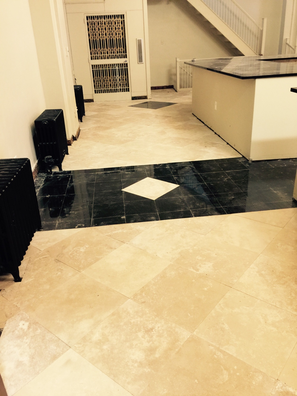 Install new travertine and marble flooring