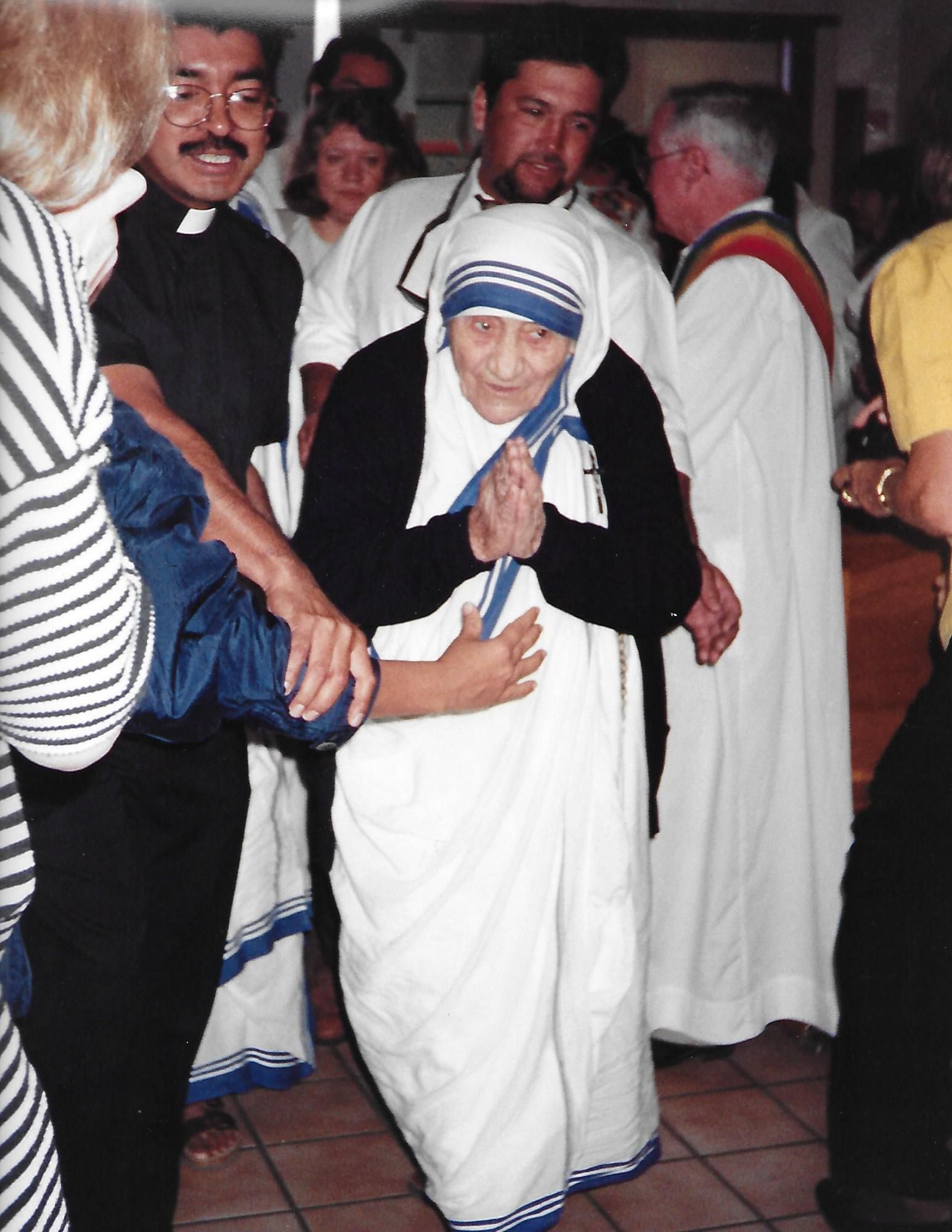 Rev. Henry Rodriguez accompanies St. Teresa of Calcutta to her seat.