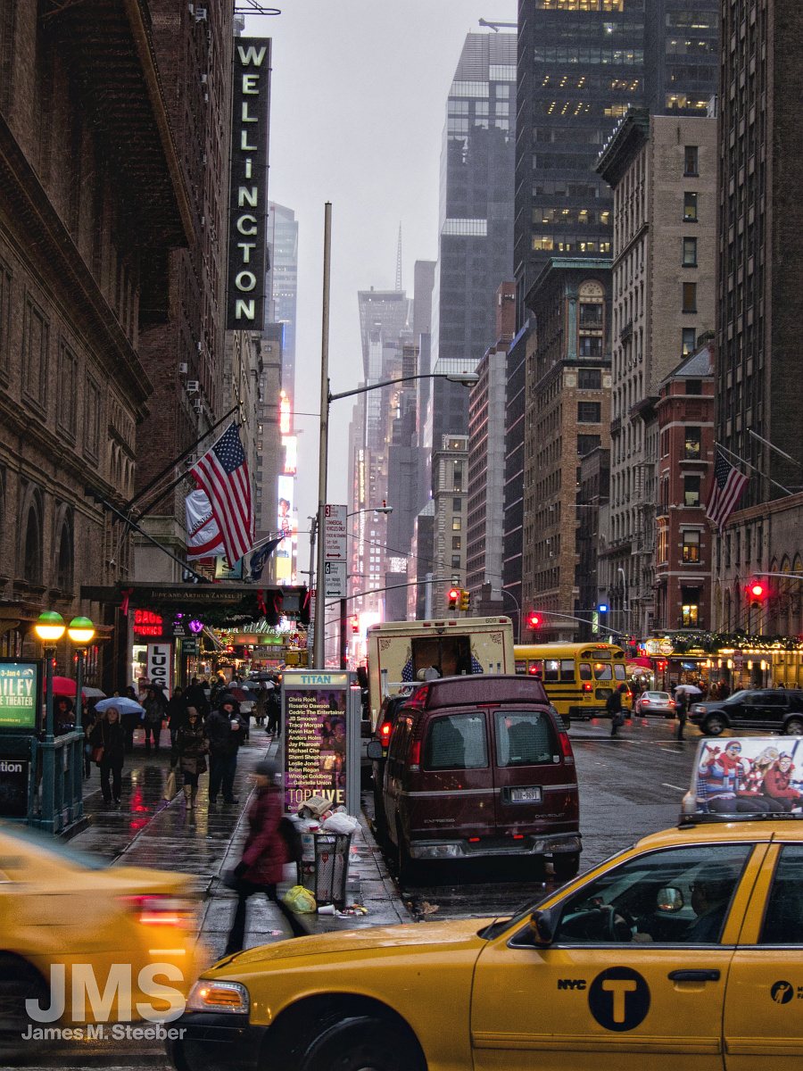 7th_Avenue_and_57th_Street_in_Rain