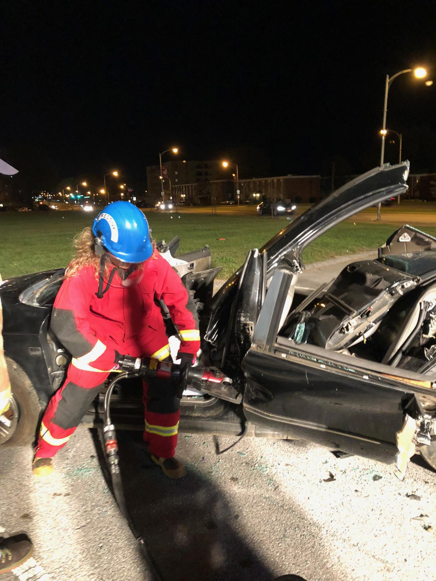 A member learning how to cut a car during extrication class.