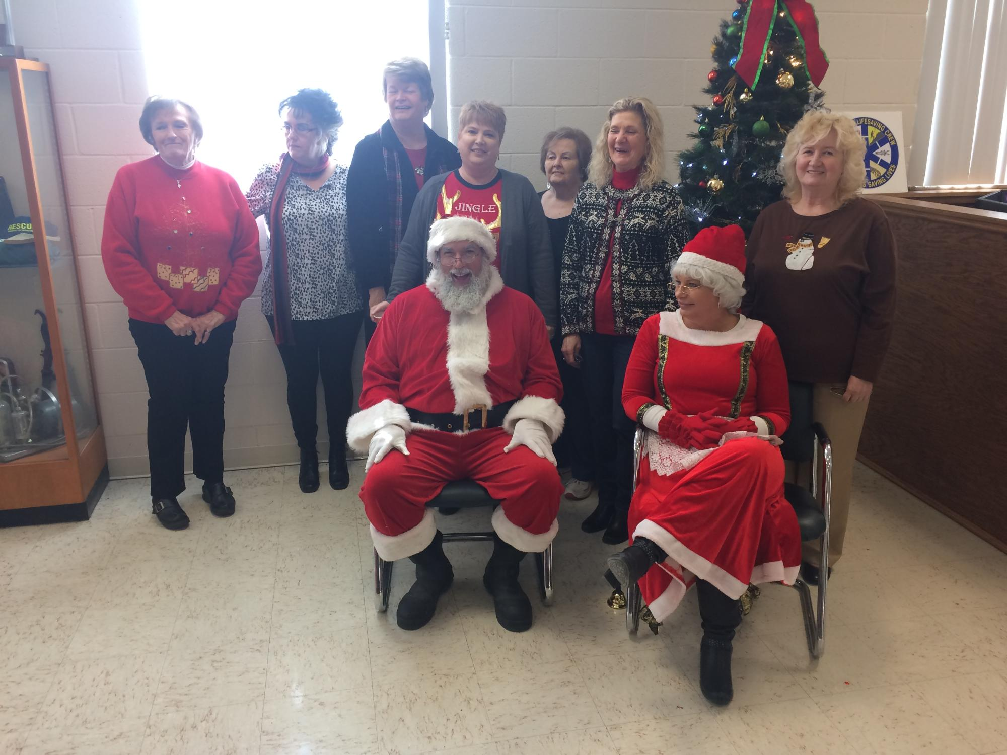 Our Crewettes with Mr. and Mrs. Clause during our Chirstmas party for the kids.