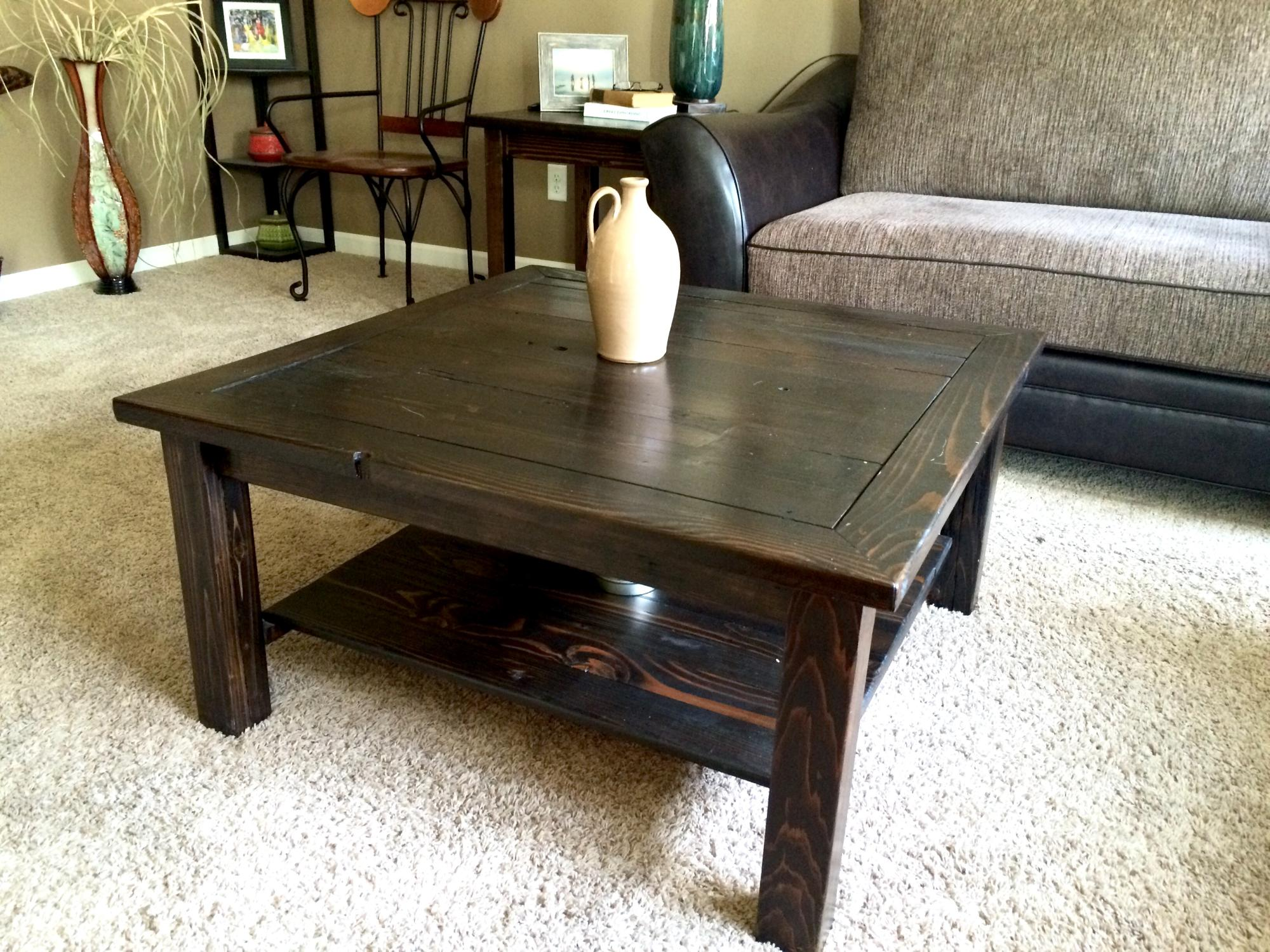 Stained drift lumber mixed wood coffee table.  36Lx36Wx18H  $400