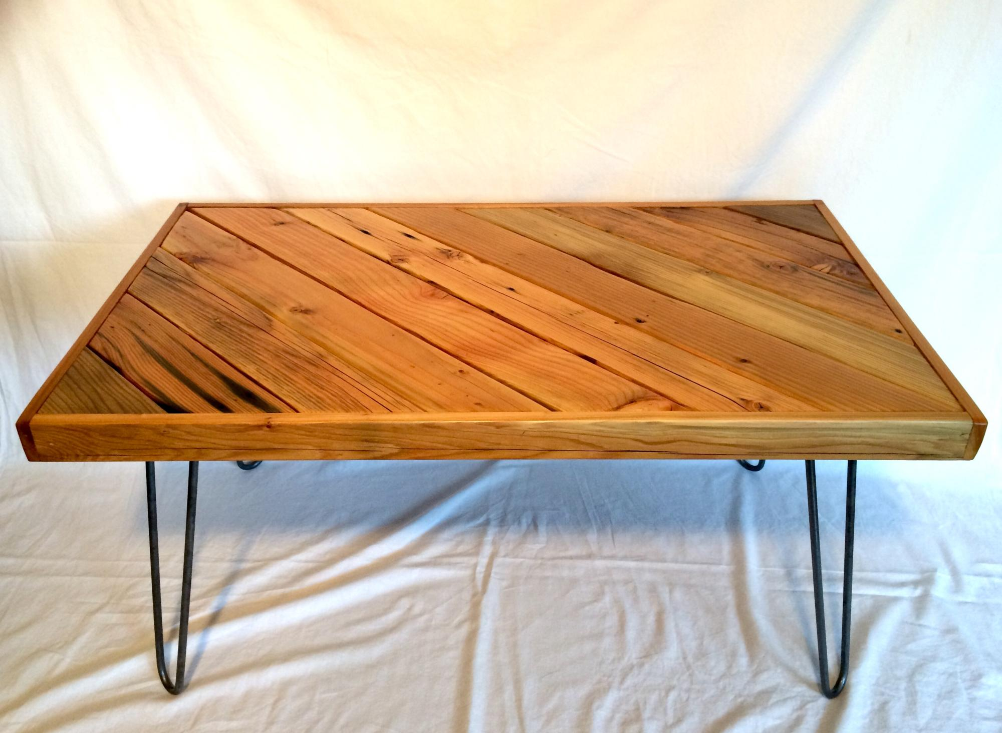 Drift lumber mixed wood diagonal coffee table  w/steel hairpin legs.  38Lx24Wx19H  $275