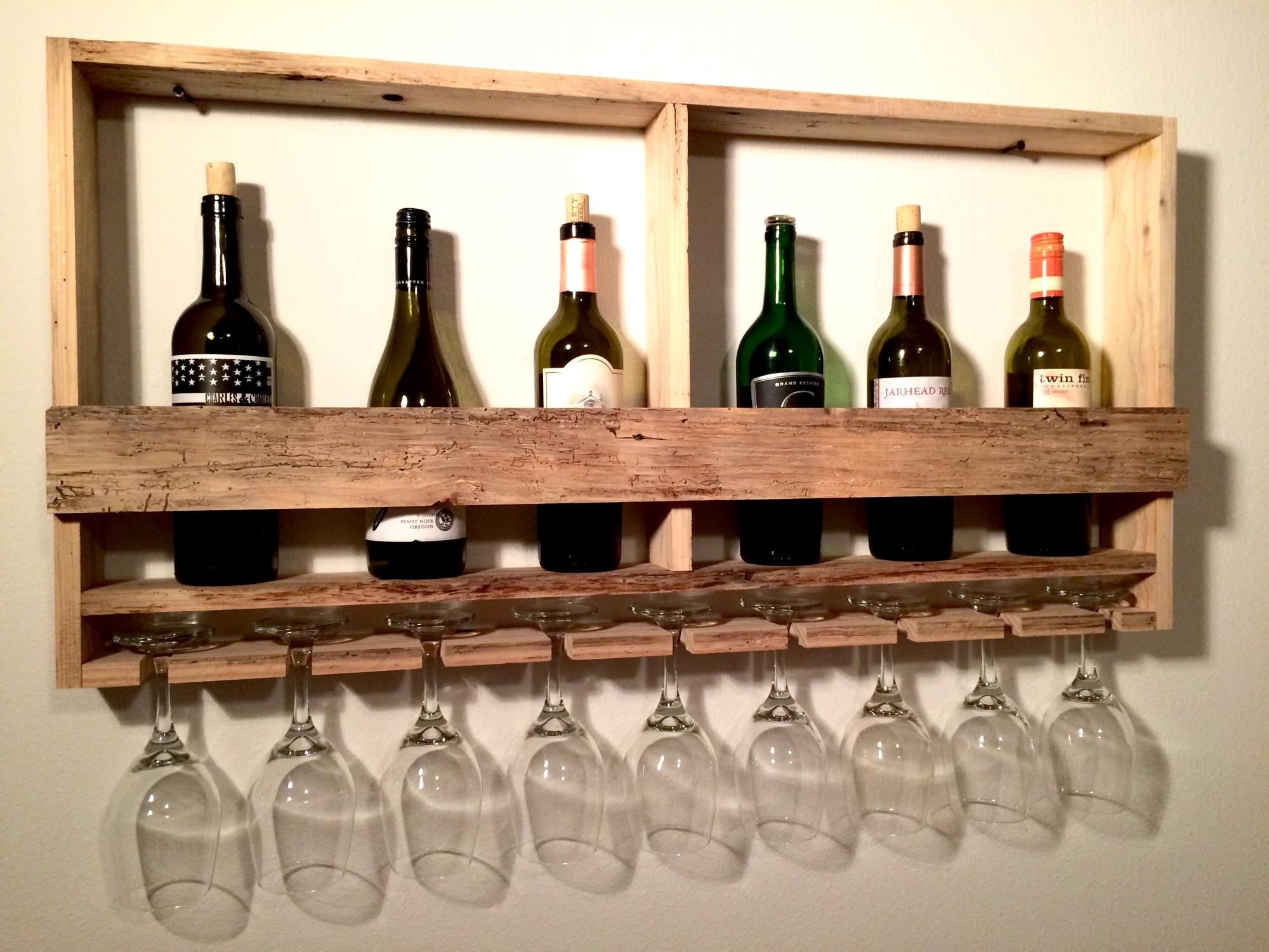 Reclaimed wood wine bottle/glass wall rack. $175