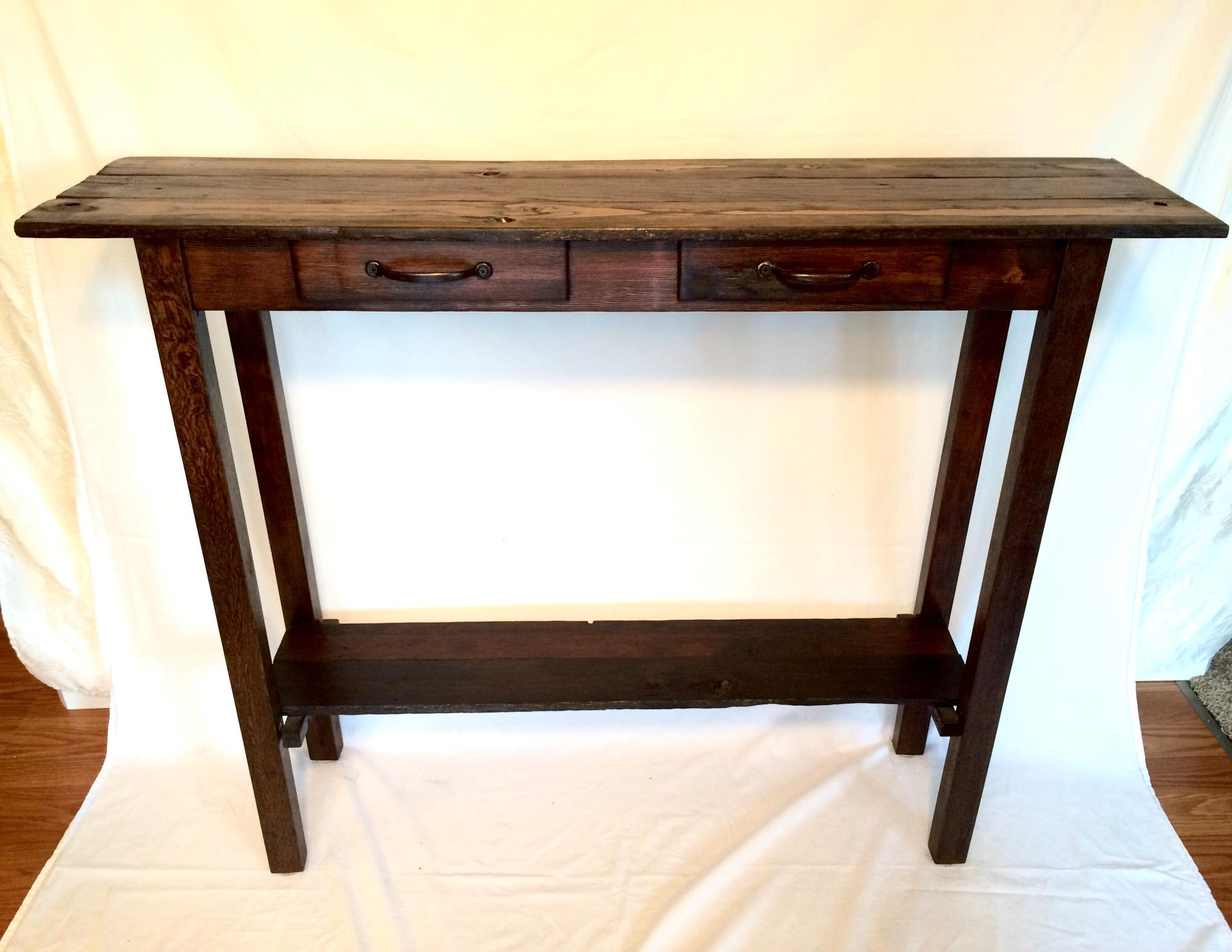 Stained drift lumber mixed wood entry table with faux drawers.  46Lx11Wx36H  $325