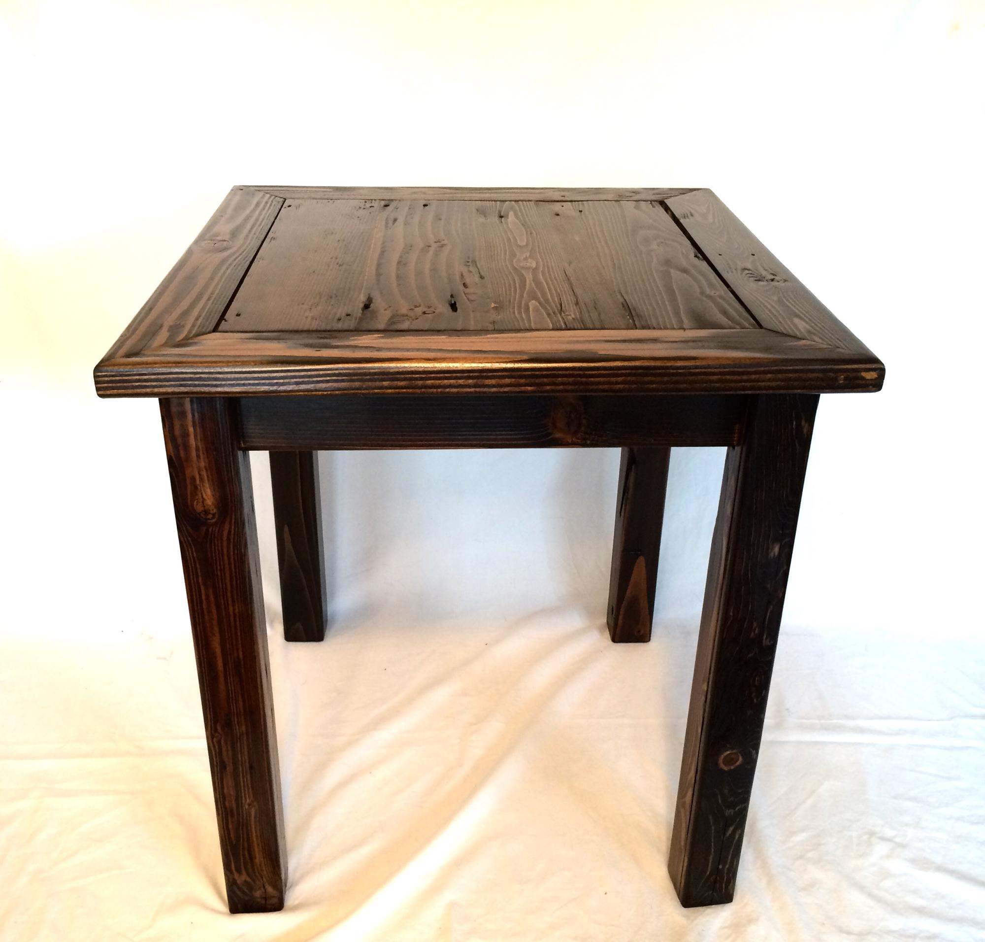 Stained drift lumber mixed wood end table.  23.5Lx23.5Wx25H  $275