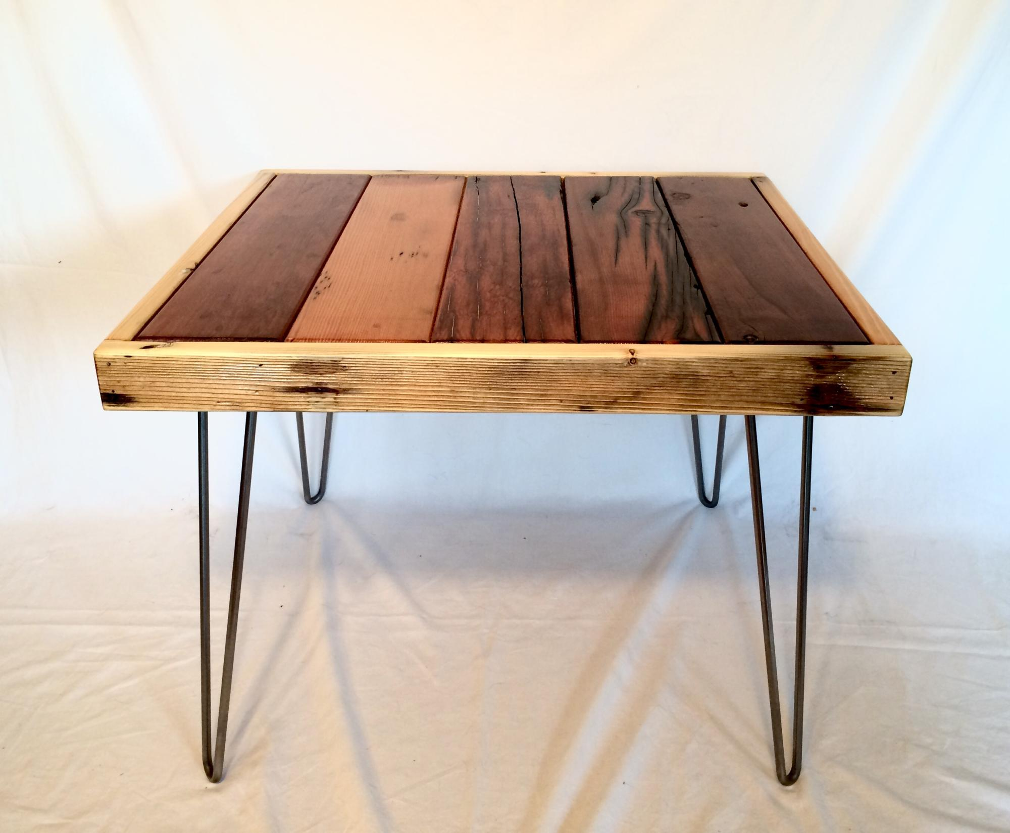 Mixed drift lumber side or coffee table w/steel hairpin legs.  26.5Lx23.5x20H  $275