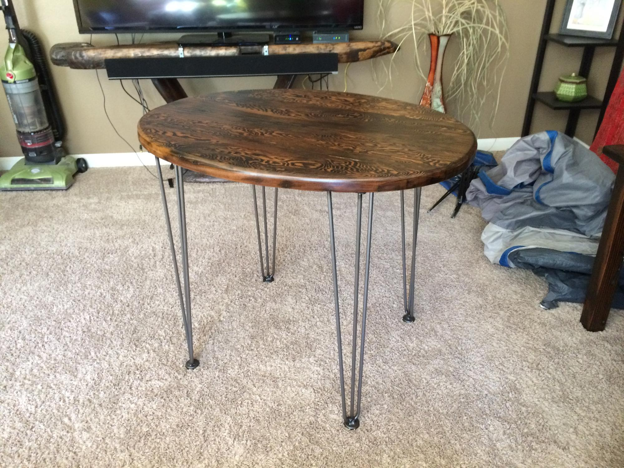 Drift lumber oval cafe table on hairpin legs $350