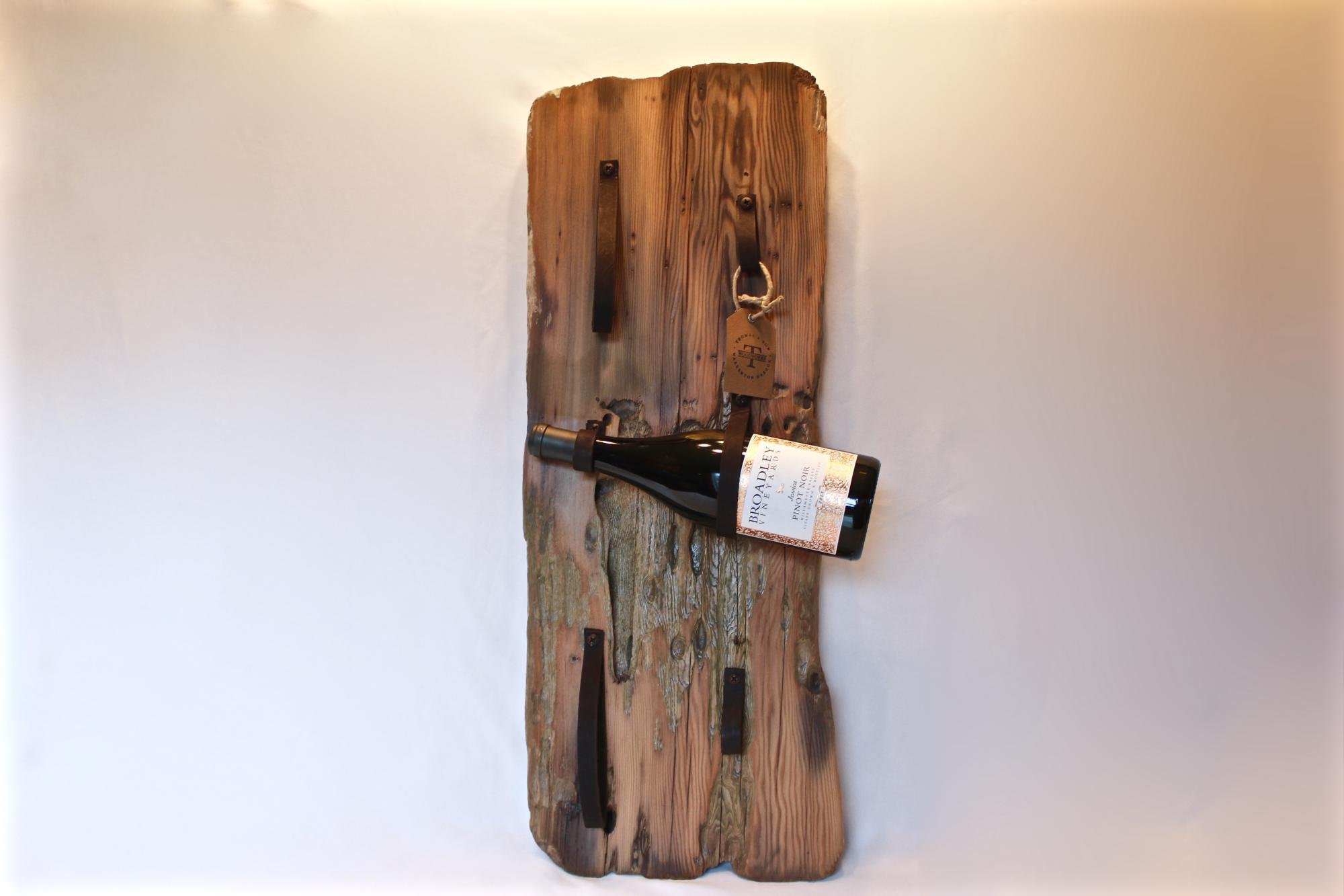 Reclaimed wood and leather wine racks. $95-$175