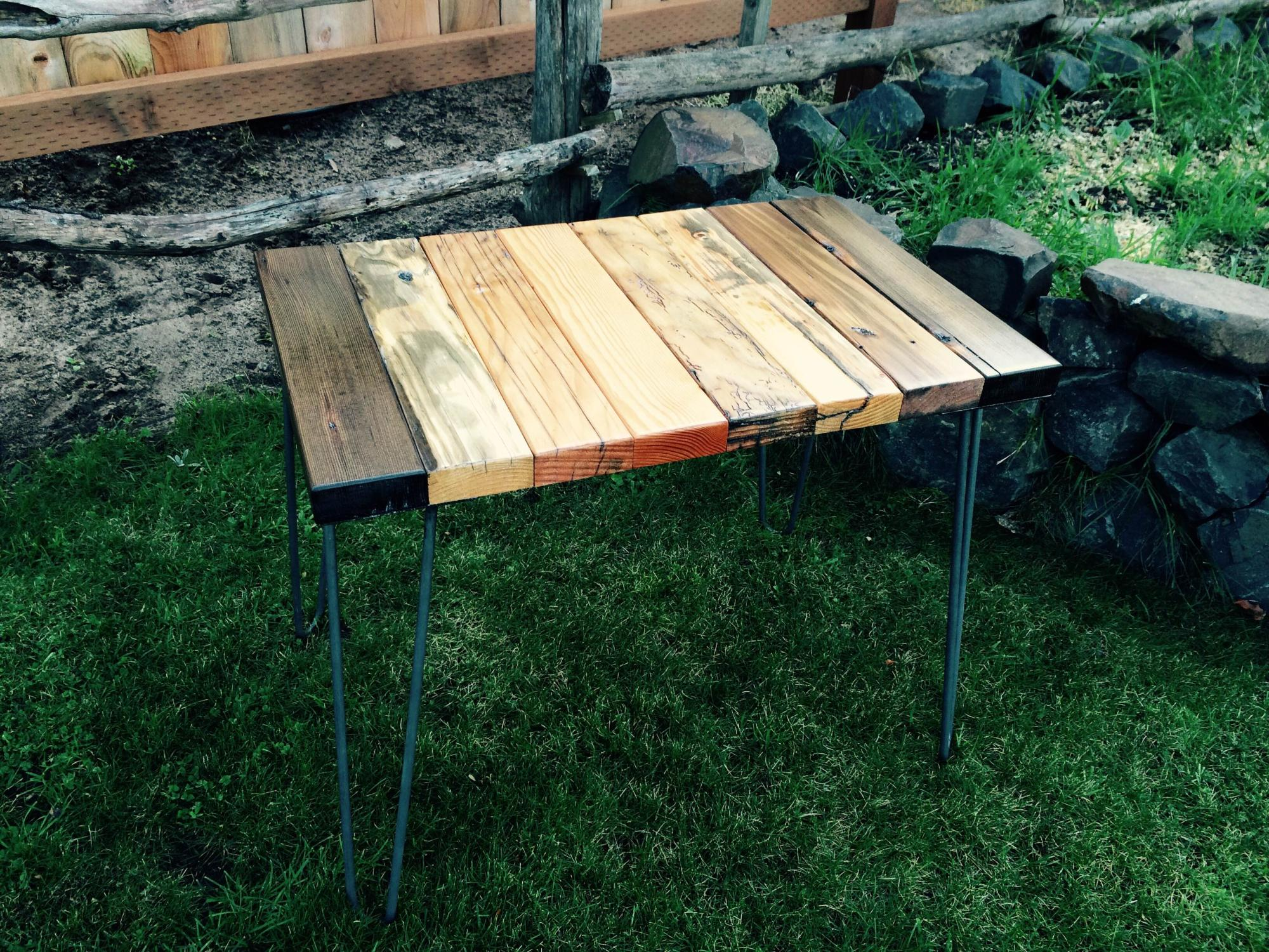 Mixed wood drift lumber end table w/steel hairpin legs.  24Lx16Wx20H  $275