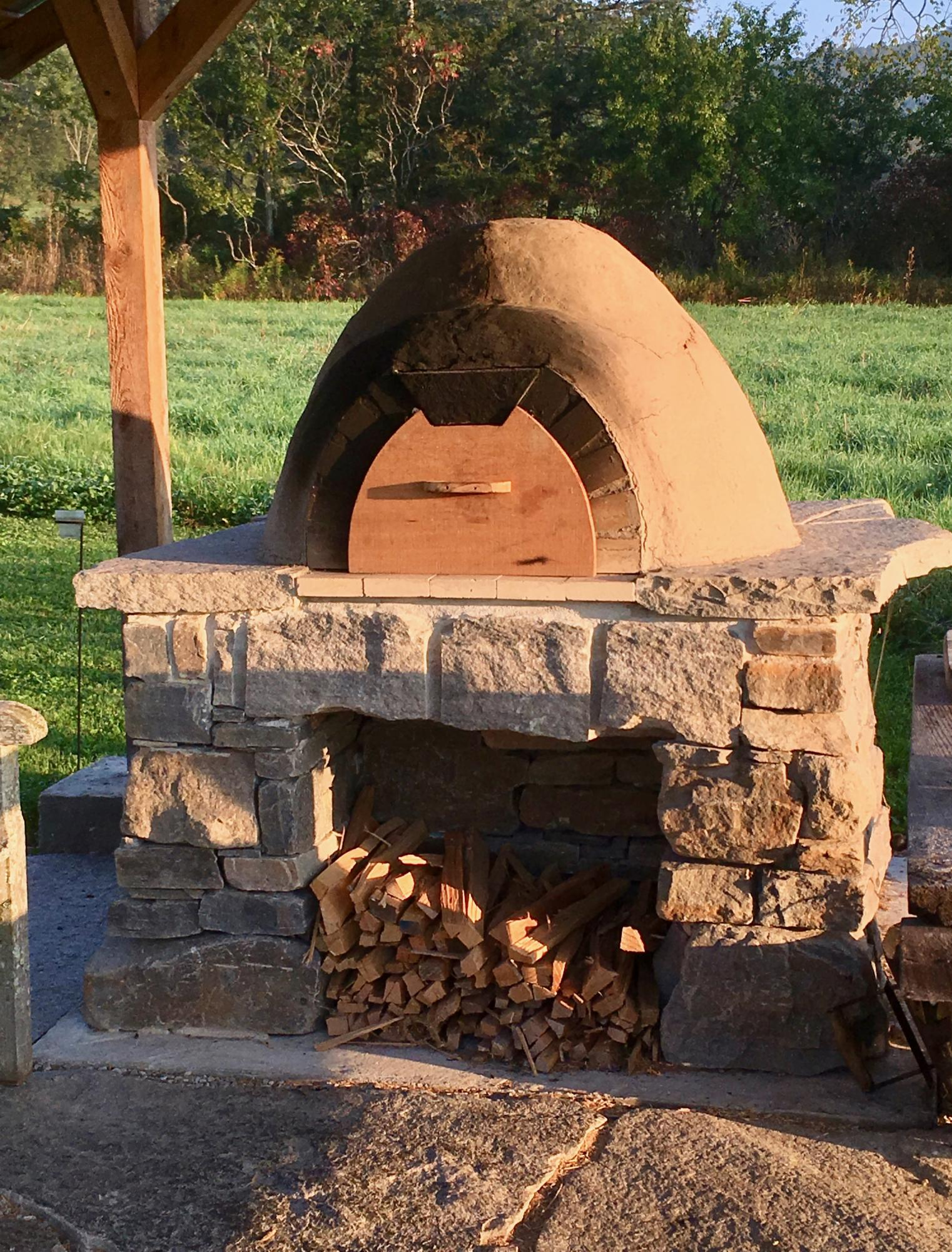 earth oven with stone base