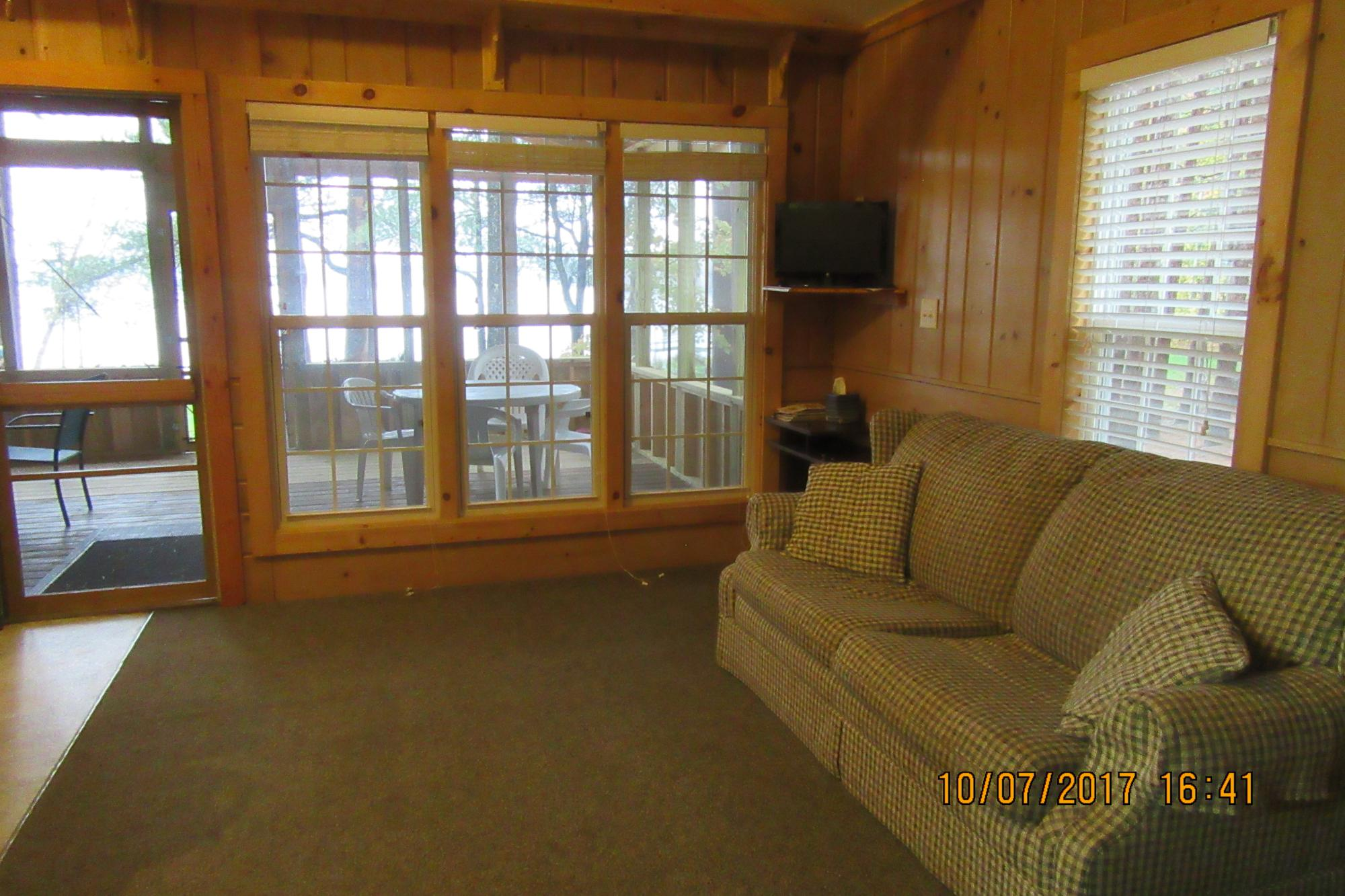 Walleye cottage living room toward screen porch