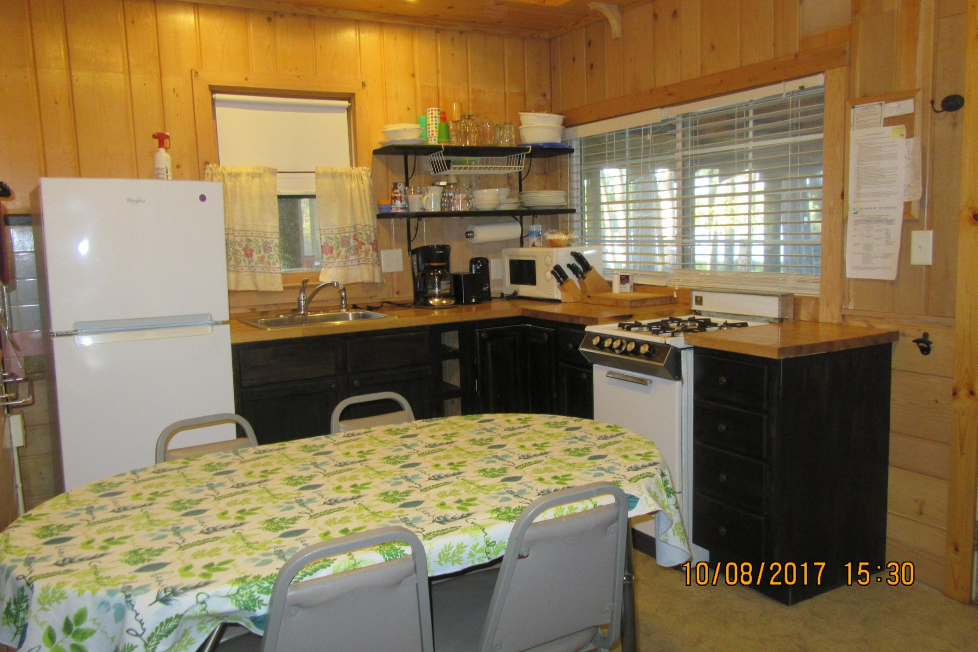 Bass Cottage kitchen toward screen porch
