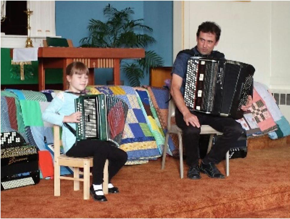 A  budding musician proudly shows her father and the audience her artistry.