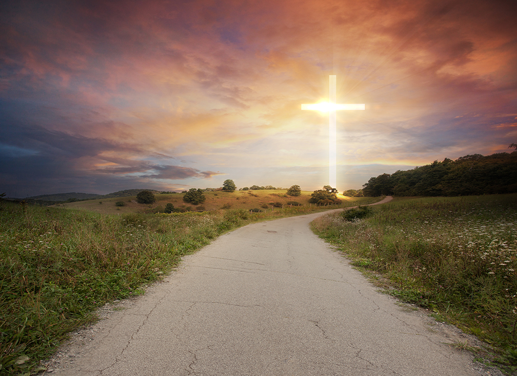 a-road-leads-up-to-a-bright-glowing-cross_SQNckkflC.jpg