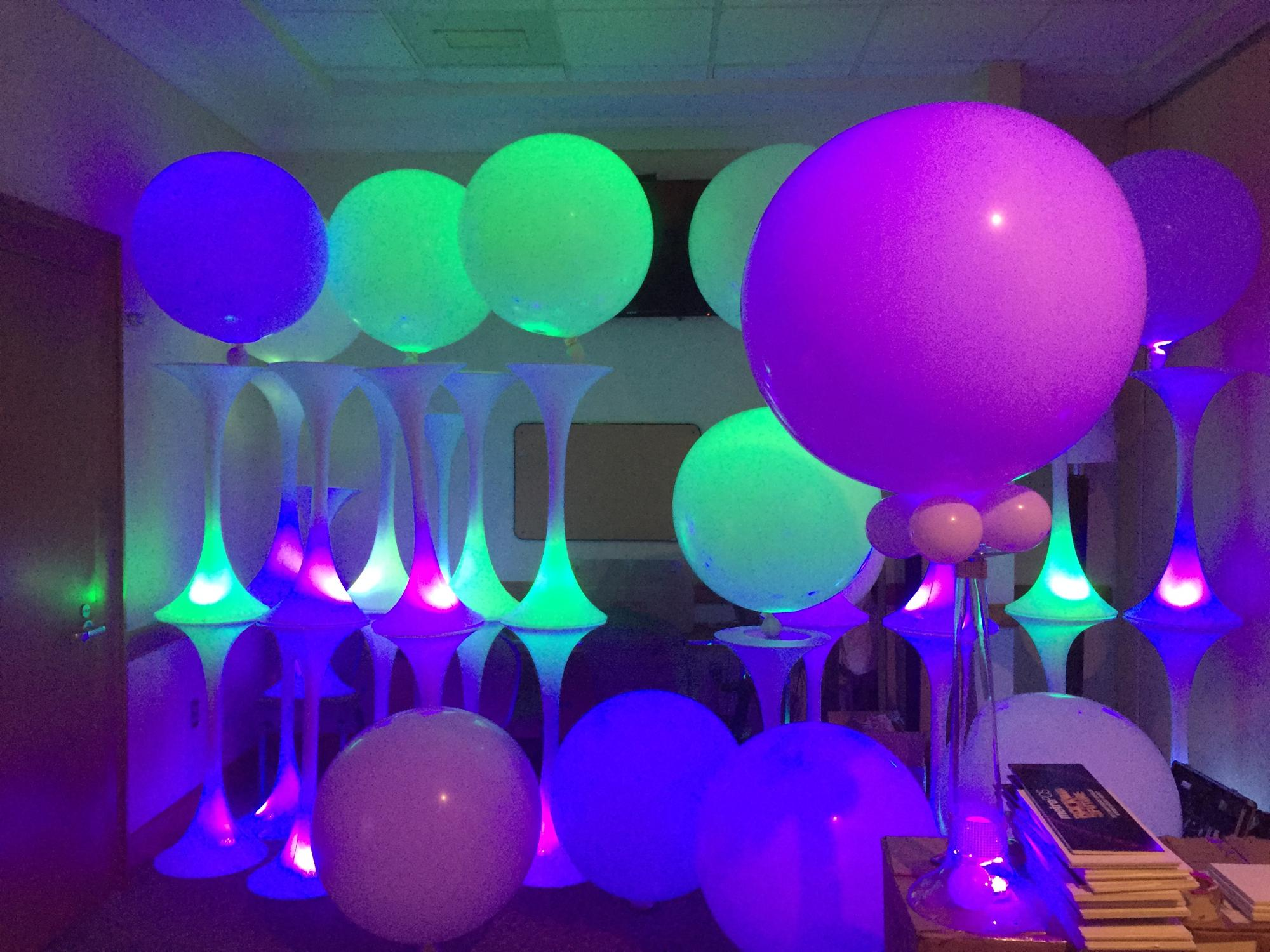 Led lights inside jumbo balloons with spandex tower