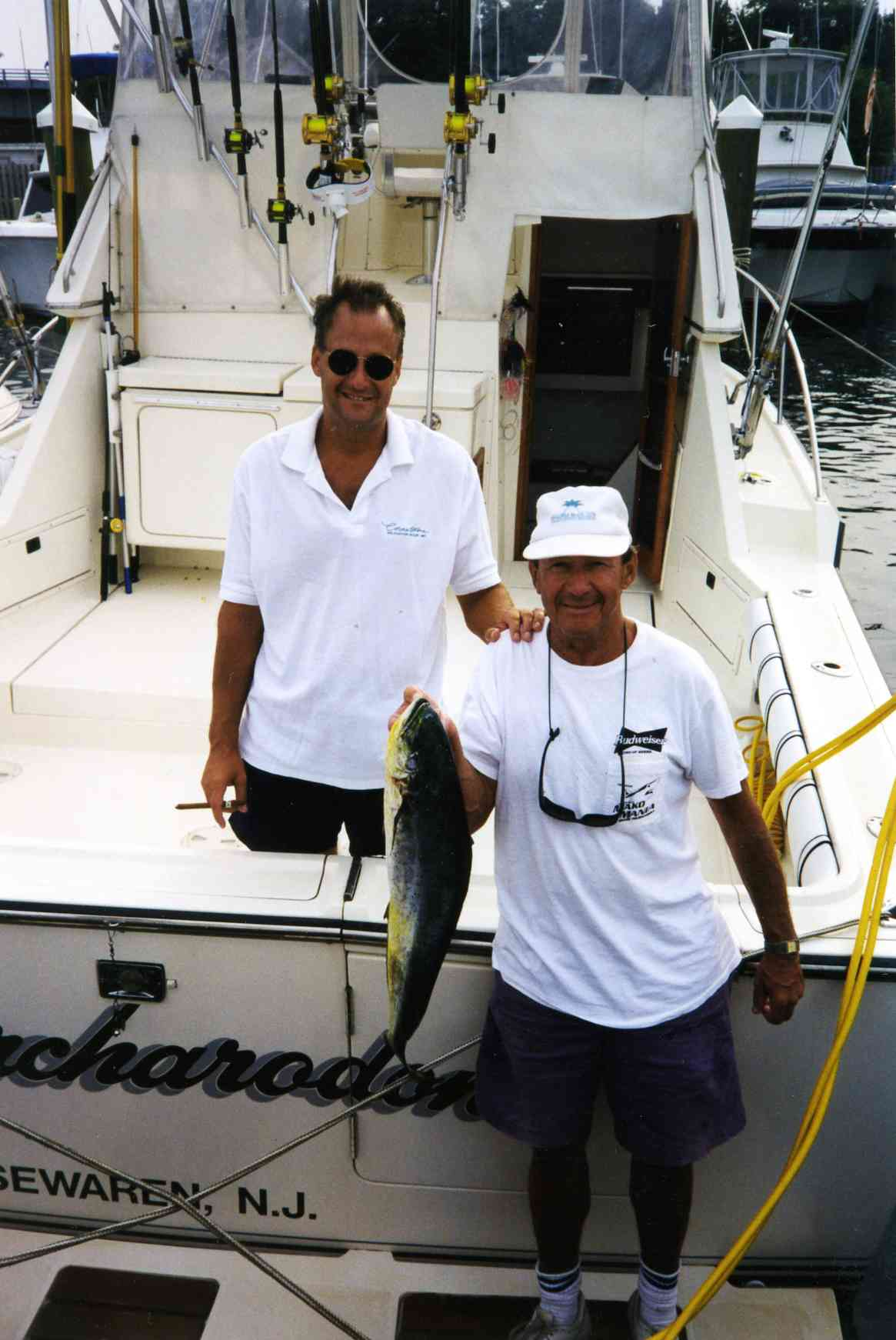 Captain_Bob___Bob_Sr_with_Mahi_on_the_first_Carcharodon.jpg