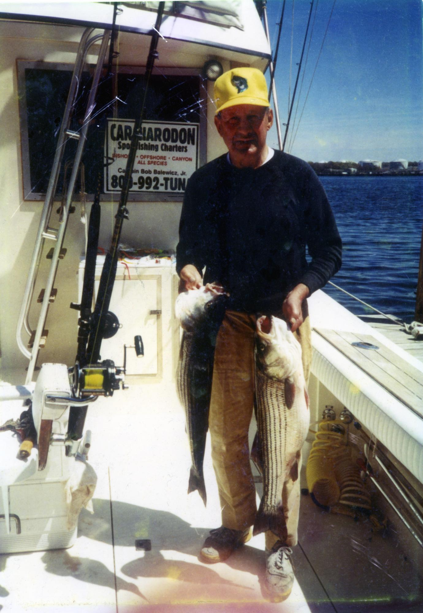Dad_with_a_nice_pair_of_Stripers_on_Carcharodon_III.jpg