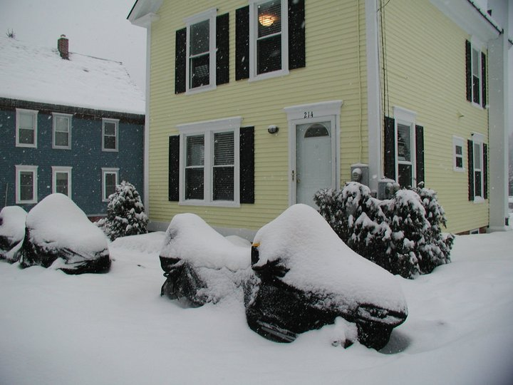 Sleds_under_covers_in_front_of_Bob_s_Ski_House.jpg