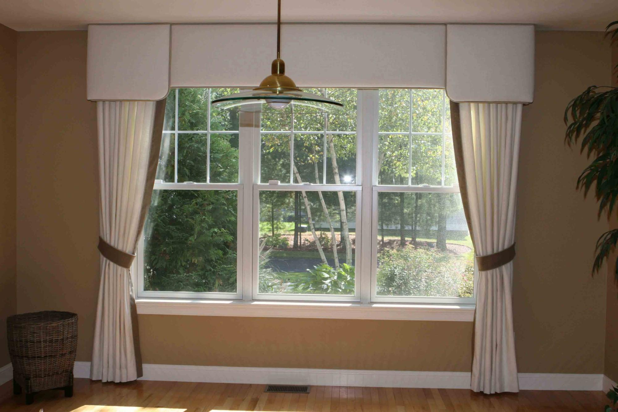 Layered upholstered cornice with drapes