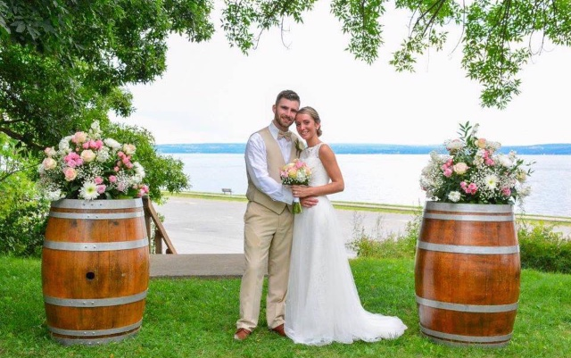 Rustic wine barrels framing a beautiful couple