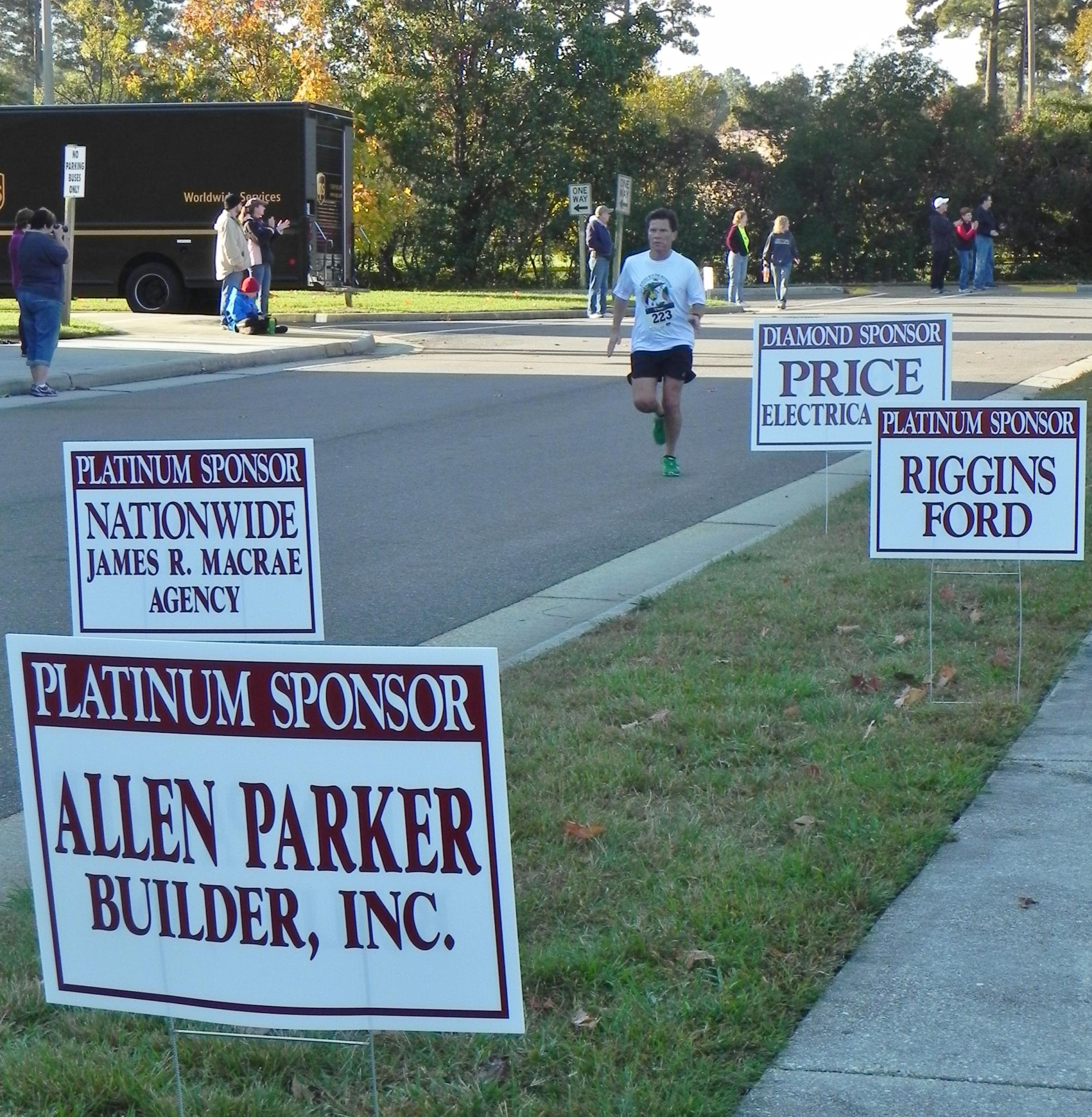 signs-at-finish-line-with-runner-oct-31-2015.jpg